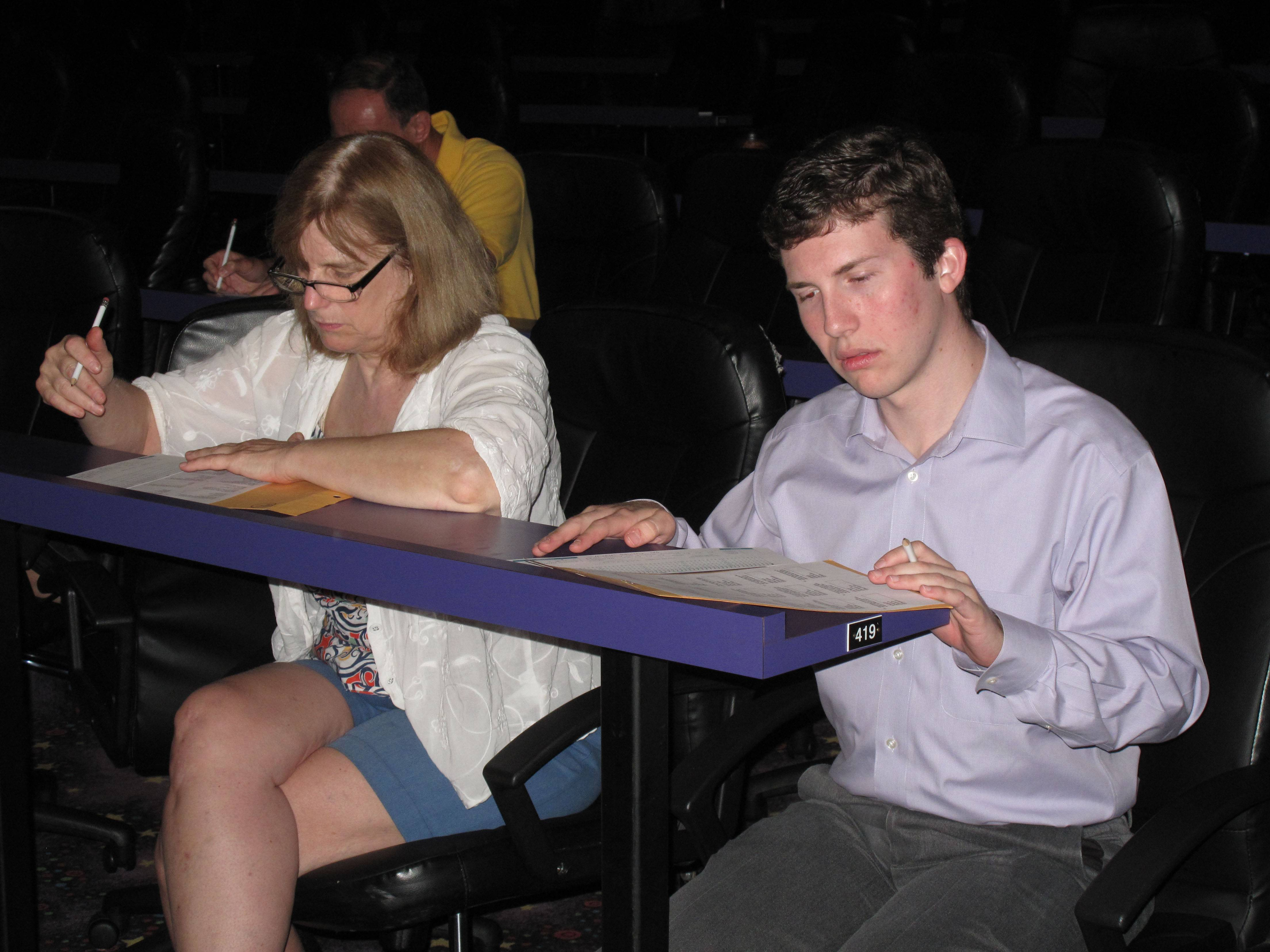 "Hilde Elg of Glen Ellyn and Michael Schwartz of Chicago begin taking a test during an audition Friday morning for the game show ""Who Wants To Be A Millionaire"" at Hollywood Palms cinema in Naperville. Both scored well enough on the test to qualify for an in-person interview with one of the show's associate producers."