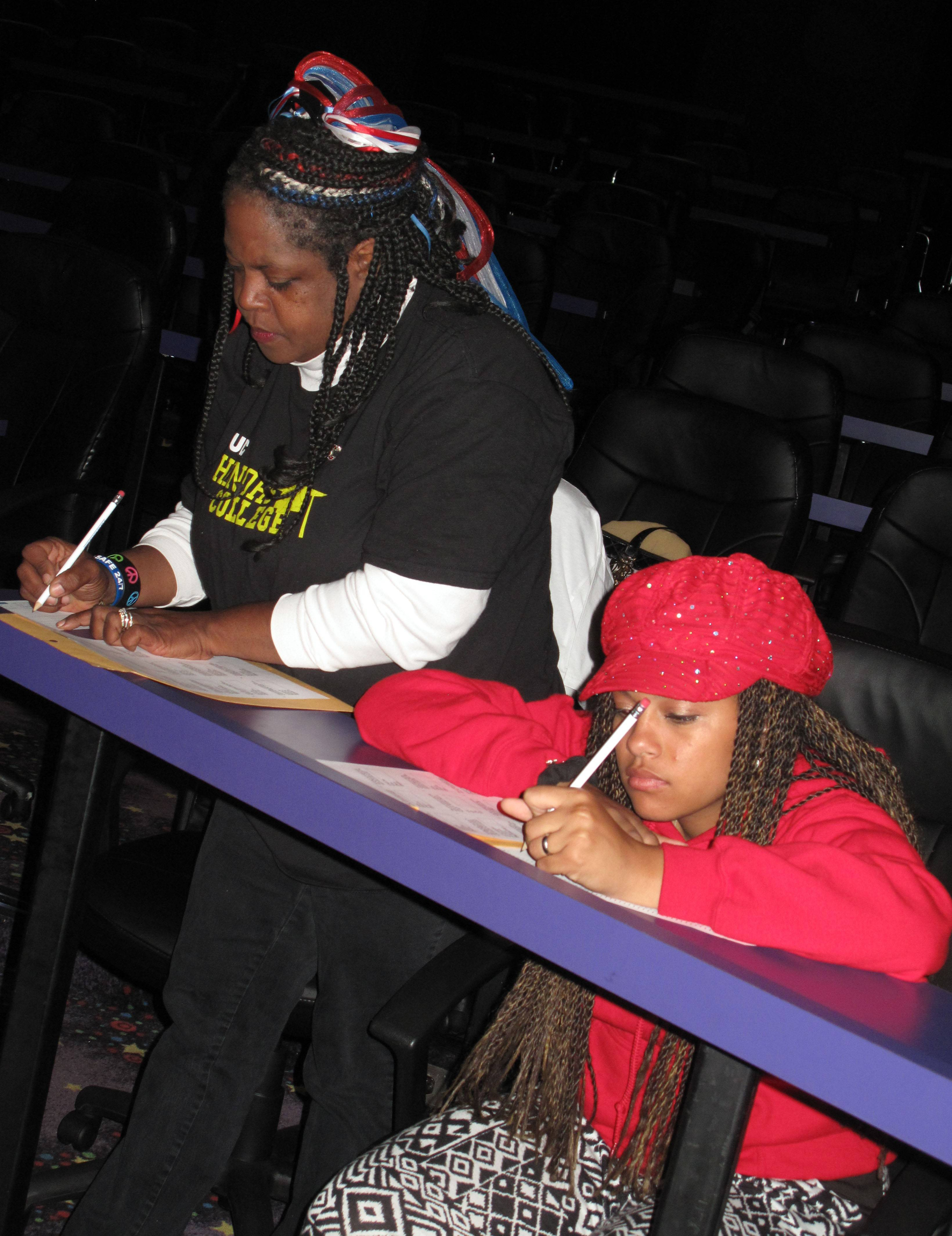 "Landa Midgley of Aurora stands to fill in test questions Friday beside her daughter, Siobhan Midgley, as both audition to be on the game show ""Who Wants To Be A Millionaire."" Hollywood Palms cinema hosted auditions Friday morning for more than 200 potential contestants."