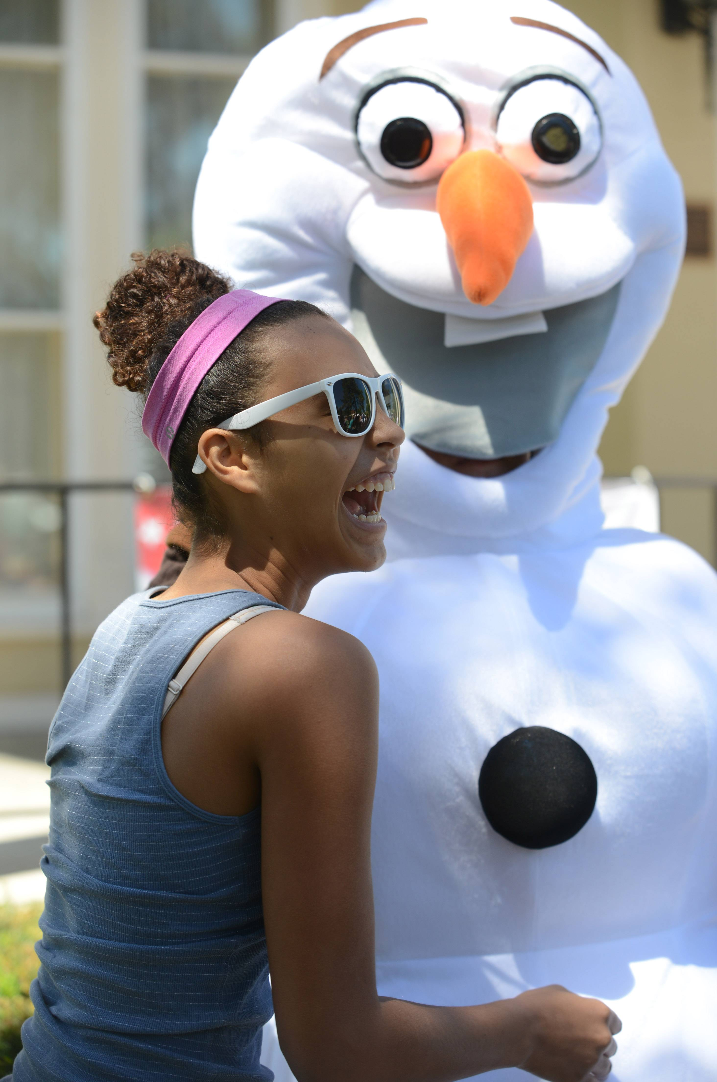 "Rachel Wright, 13, of Mundelein is about to give Olaf, a character from the movie ""Frozen,"" a big hug."