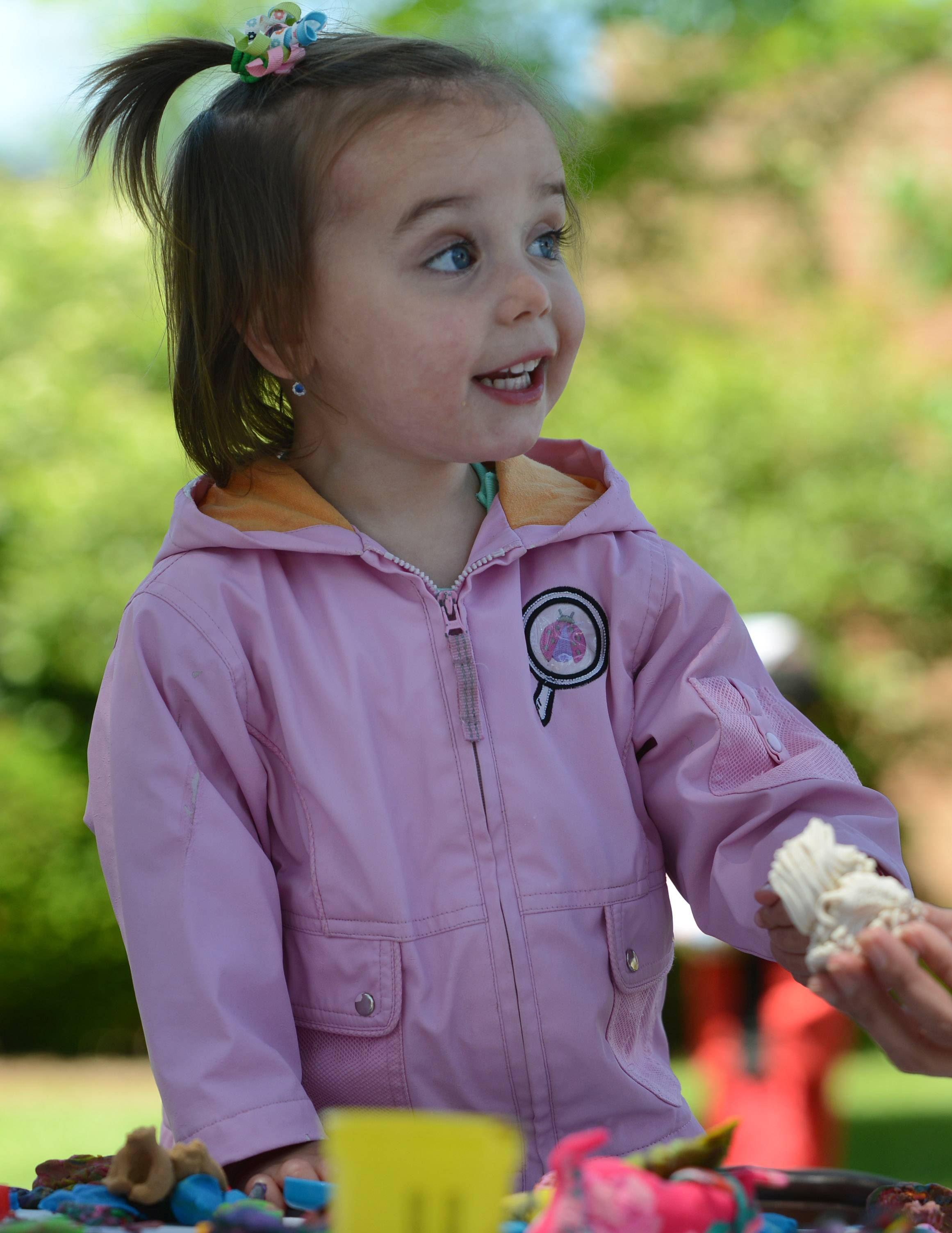 Vicky Gracias, 2, of Libertyville plays at one of the activity tables Friday morning.