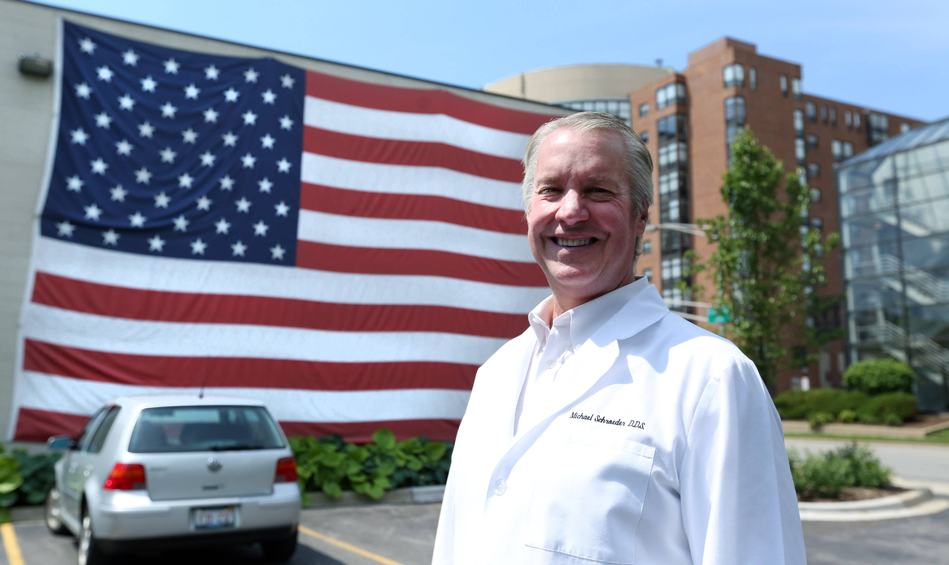 Dr. Michael B. Schroeder had this 40-foot-wide flag placed on the side of the Arlington Heights building that is home to his dental practice.