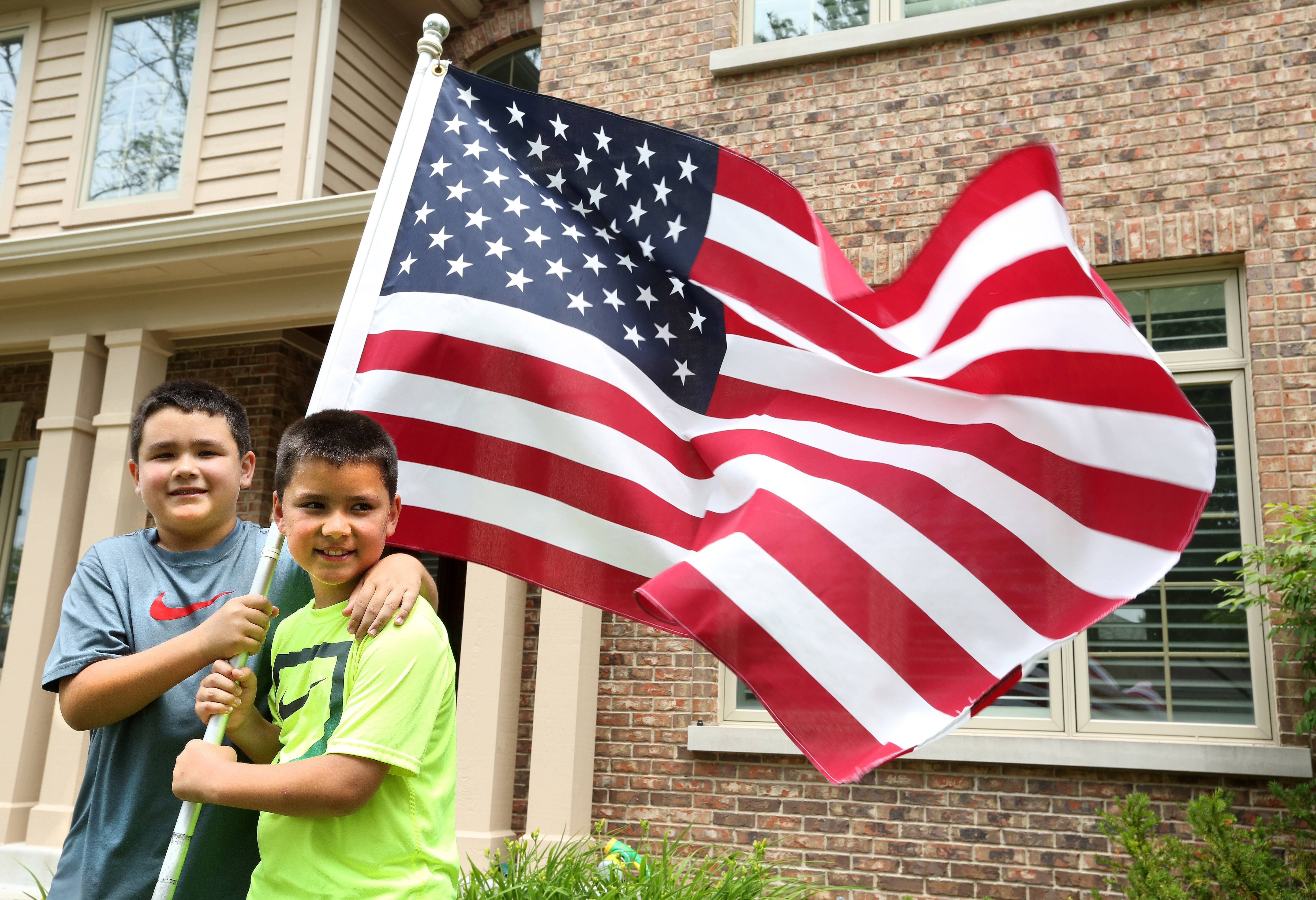 Ten year-old twins Austin, left, and Owen Tanabe say to them the flag honors their grandfather's memory.