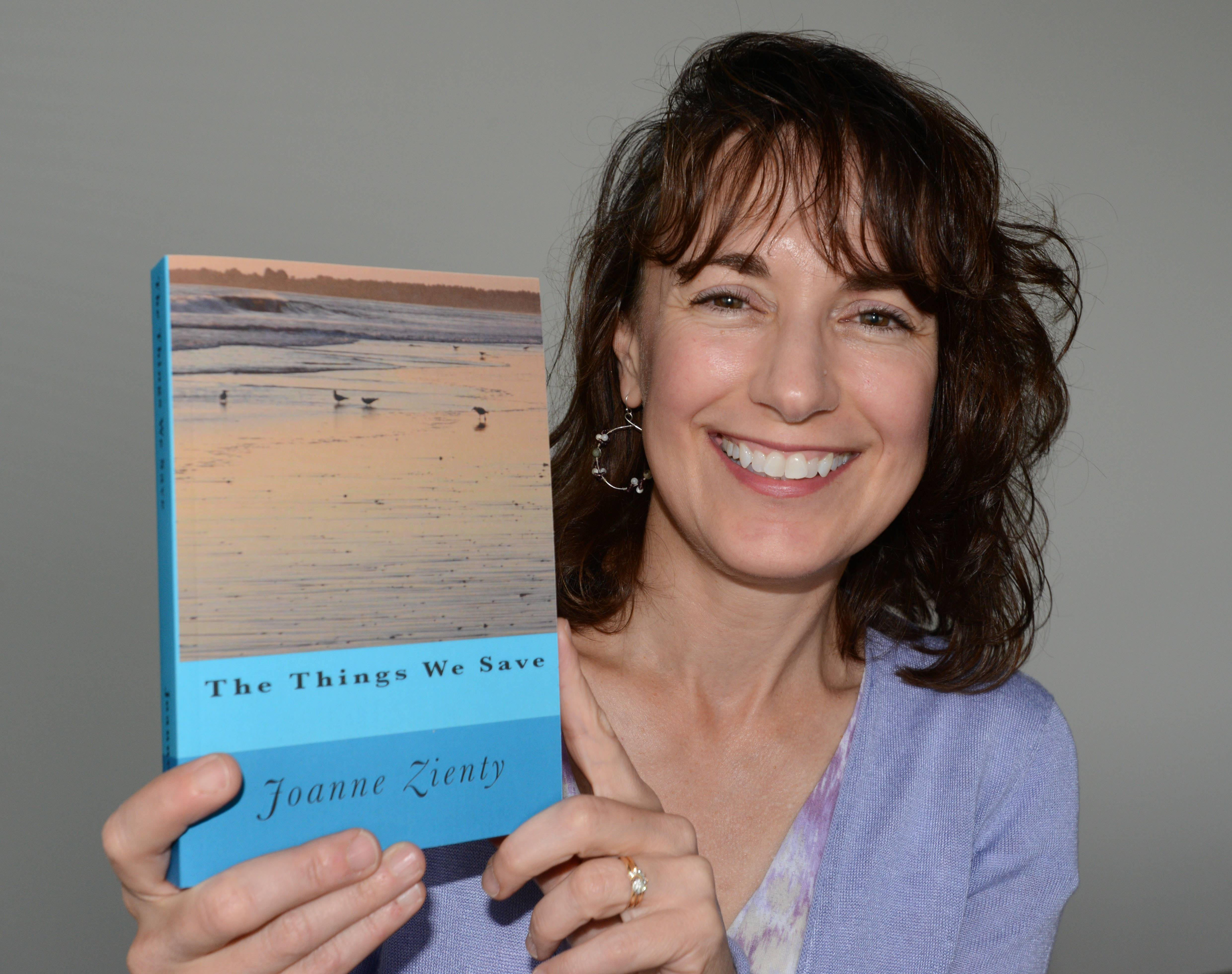 "Joanne Zienty of Wheaton wrote ""The Things We Save,"" the novel that made her the winner of the first Soon to Be Famous Illinois Author Project. Her own cache of saved memorabilia that she carries in her purse include her mother's rosary, a pen from her father's workplace, a crucifix and St. Christopher's medal from a brother who died as a child, seashells from Florida, and small rocks from the Indiana Dunes."