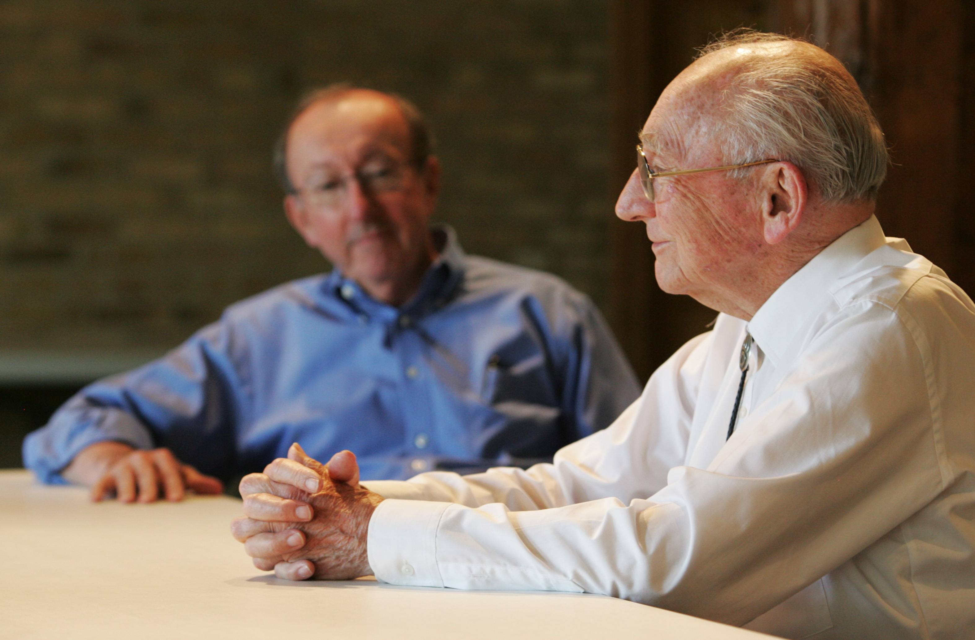 In this 2011 photo, Jack Roeser, right, and his son, Tom, discuss the past and future of Otto Engineering as the company celebrated 50 years in Carpentersville.