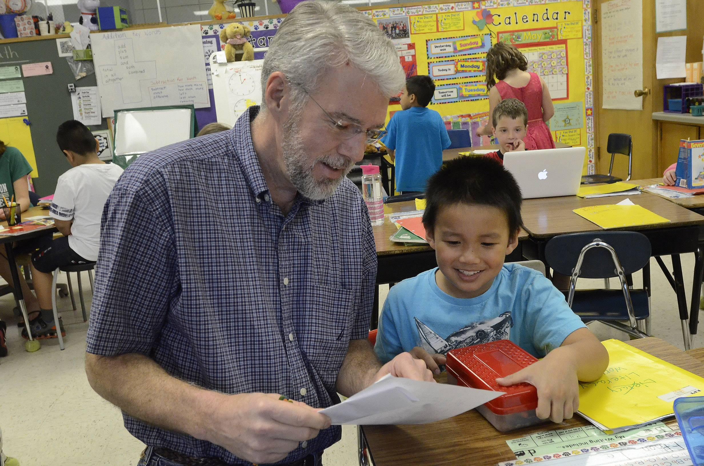 Grandpa Mark Stein works with a second-grader in Heidi Sansone's class at Washington School in Mundelein.
