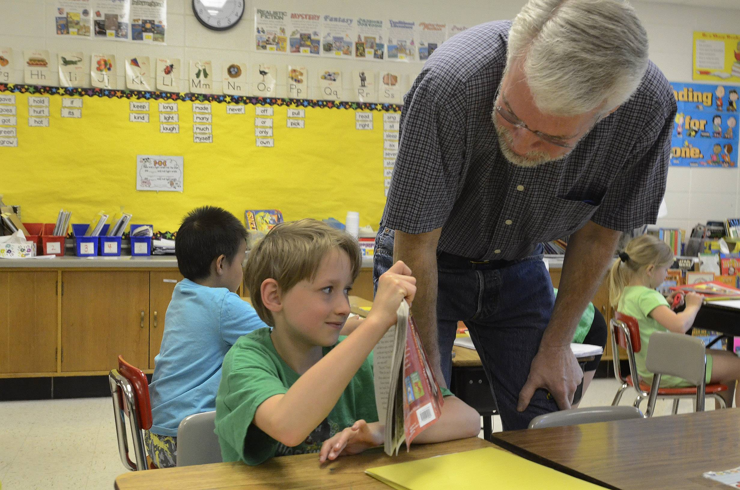 Mark Stein checks on his grandson Max Weir in his second-grade class at the school.