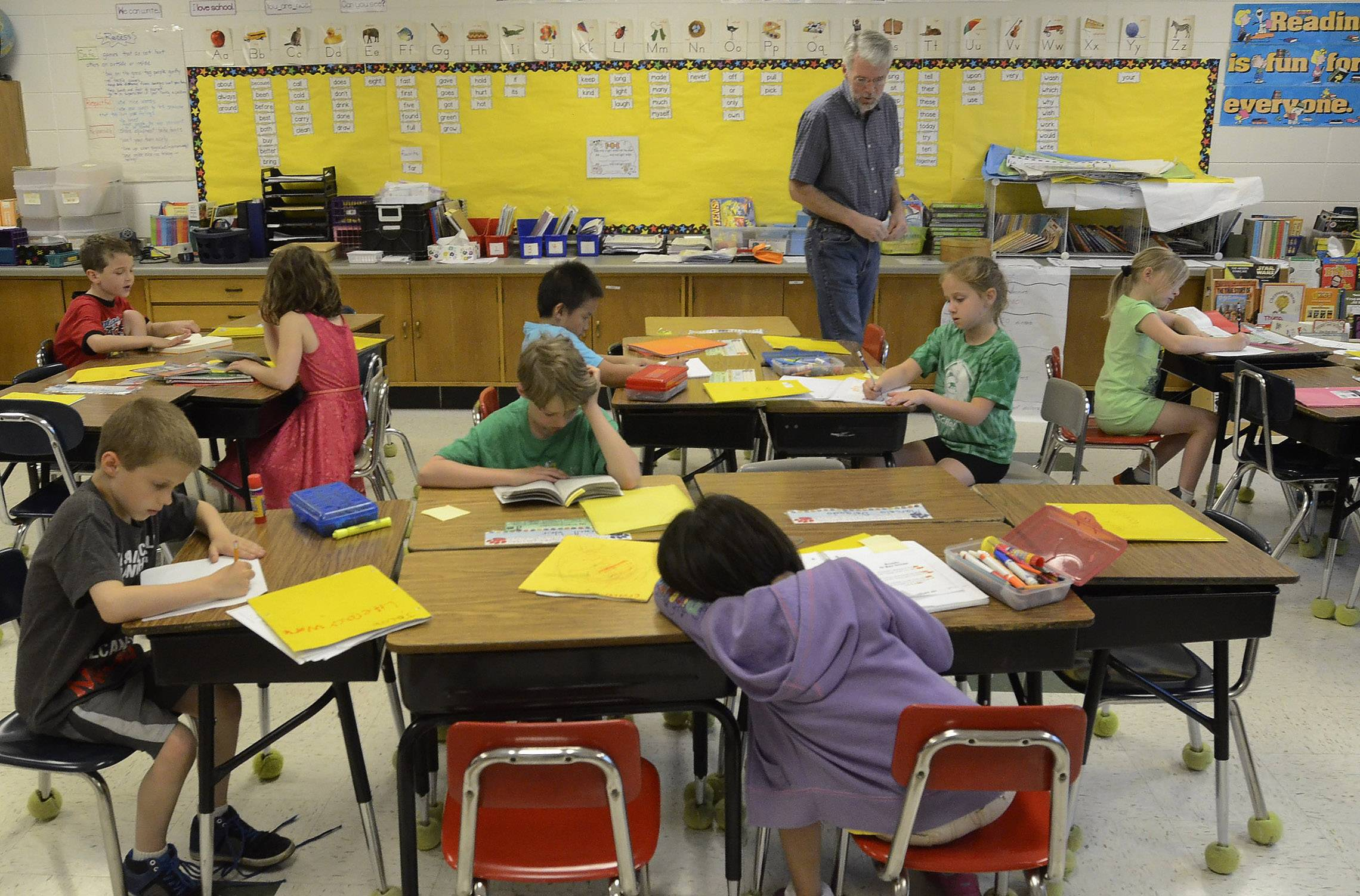 Grandpa Mark Stein helps out in Heidi Sansone's second-grade class at Washington School where his grandson Max Weir is a student.