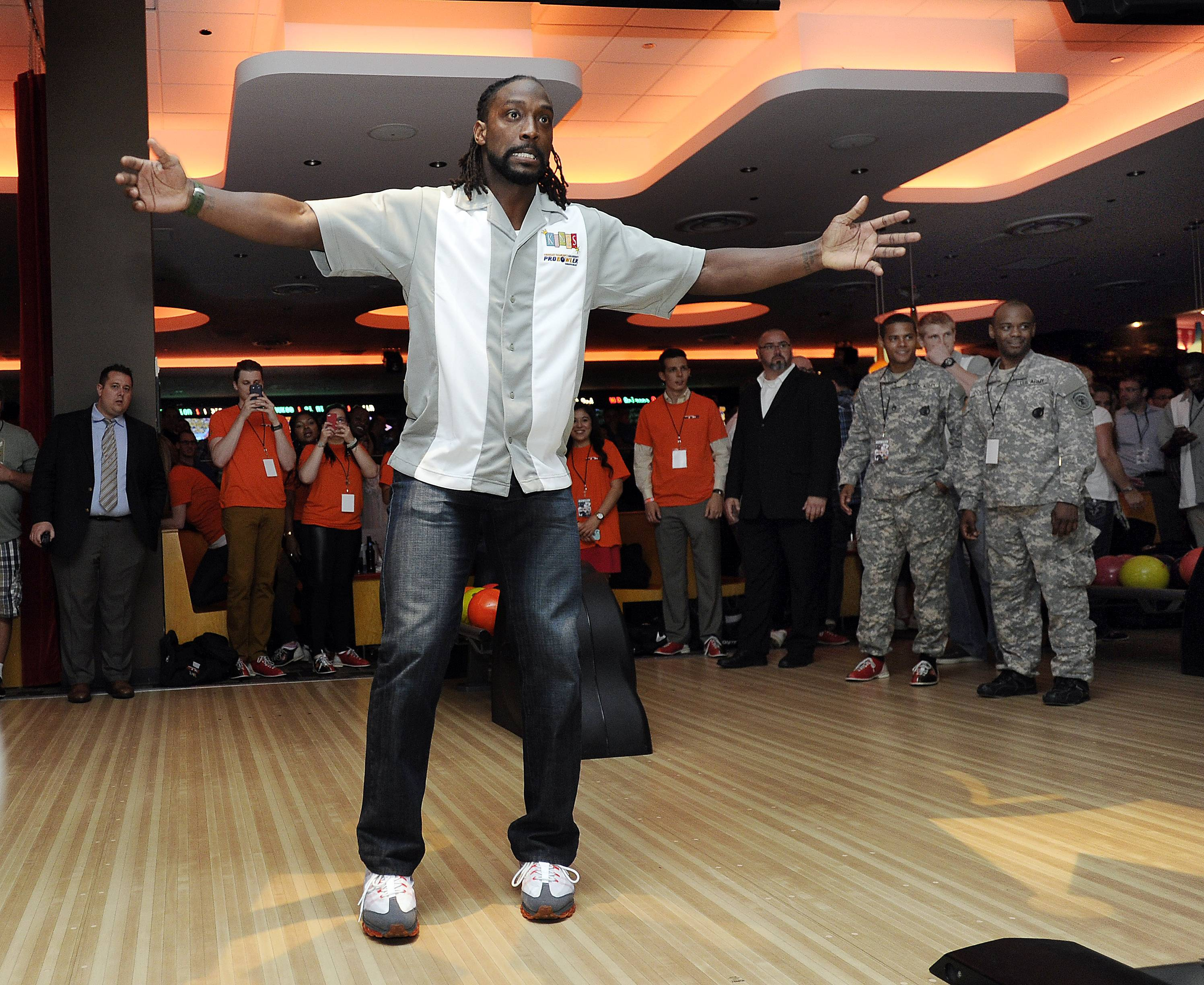 Charles Tillman reacts to his throw as he kicks off his bowling tournament Thursday in Rosemont.