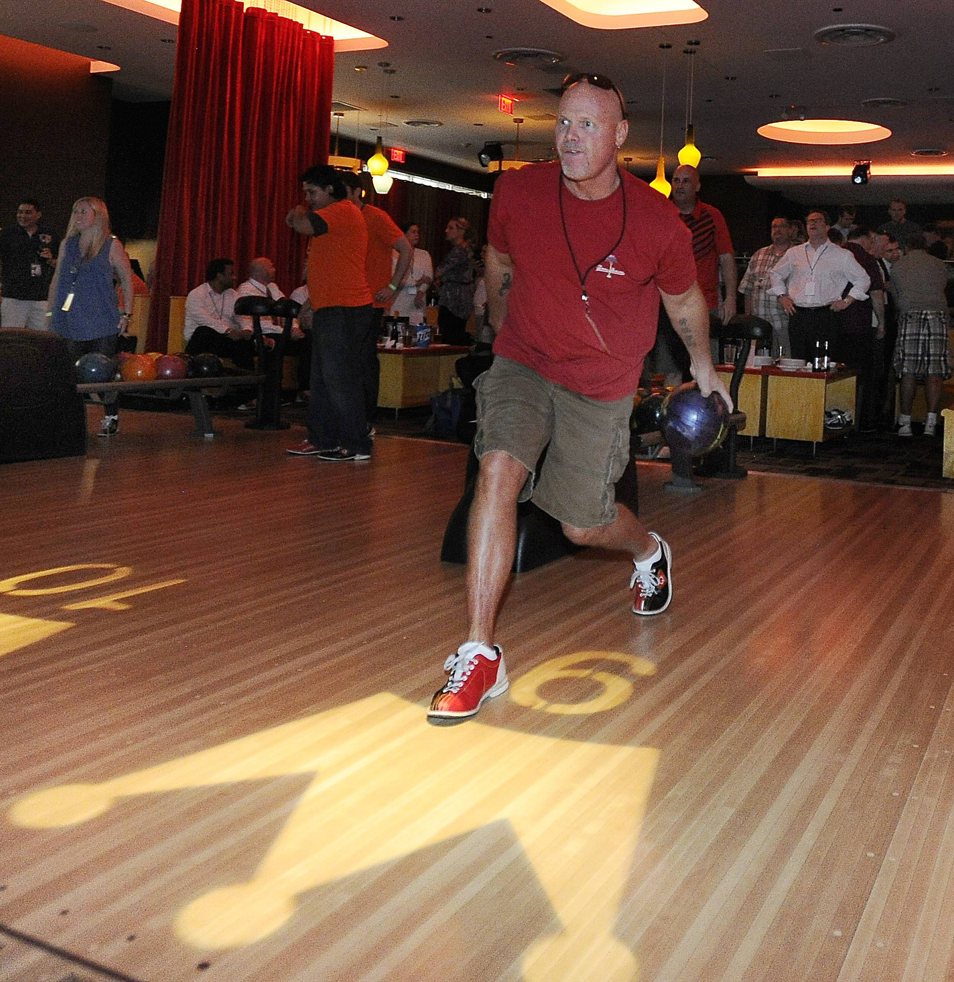 Former Bears quarterback Jim McMahon bowls Thursday night in the third annual Charles Tillman Celebrity Pro BOWLer Tournament in Rosemont.