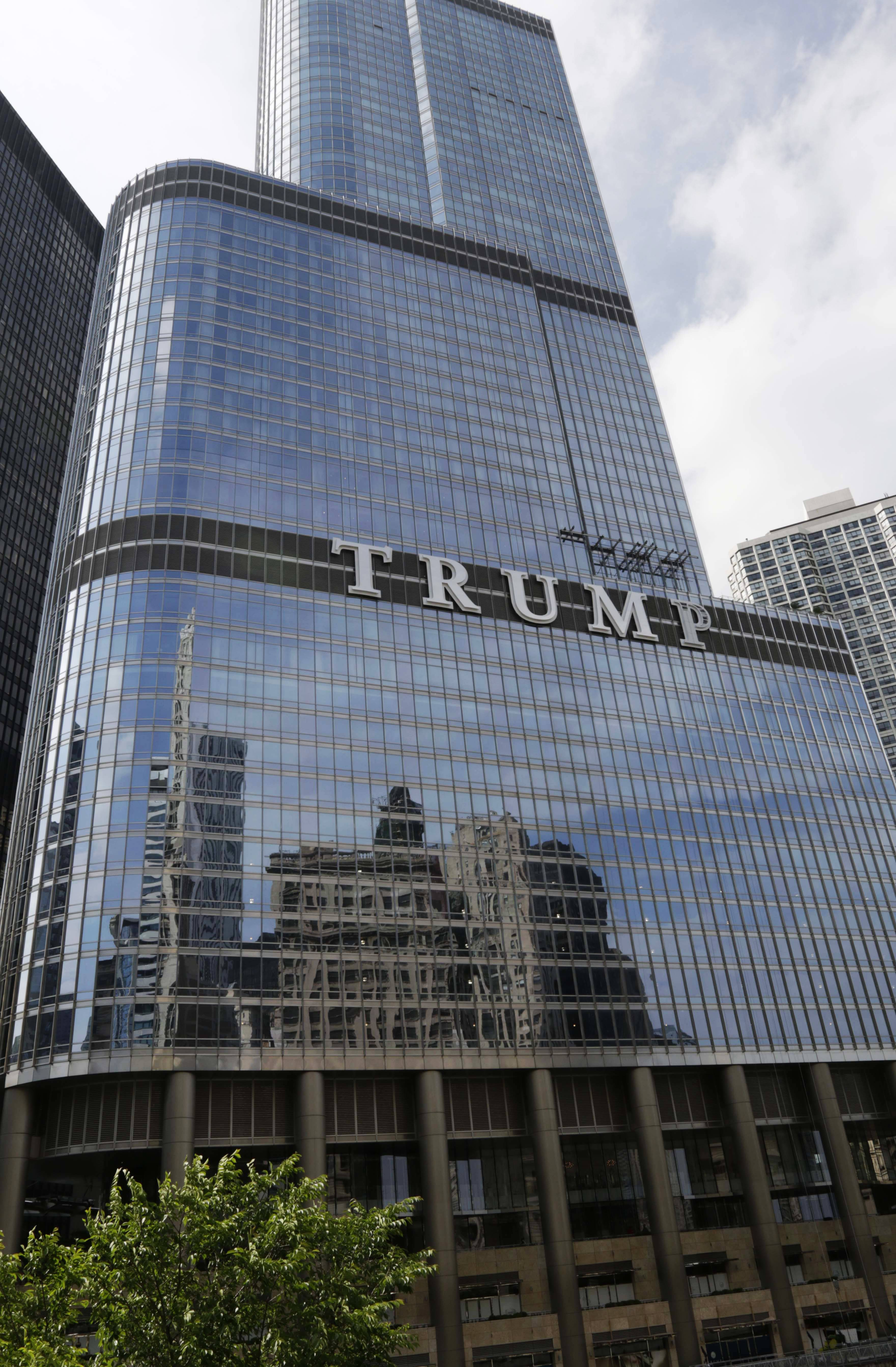 Newly installed 20-foot-tall letters spelling out T-R-U-M-P stand on the side real estate billionaire Donald Trump's skyscraper in Chicago.