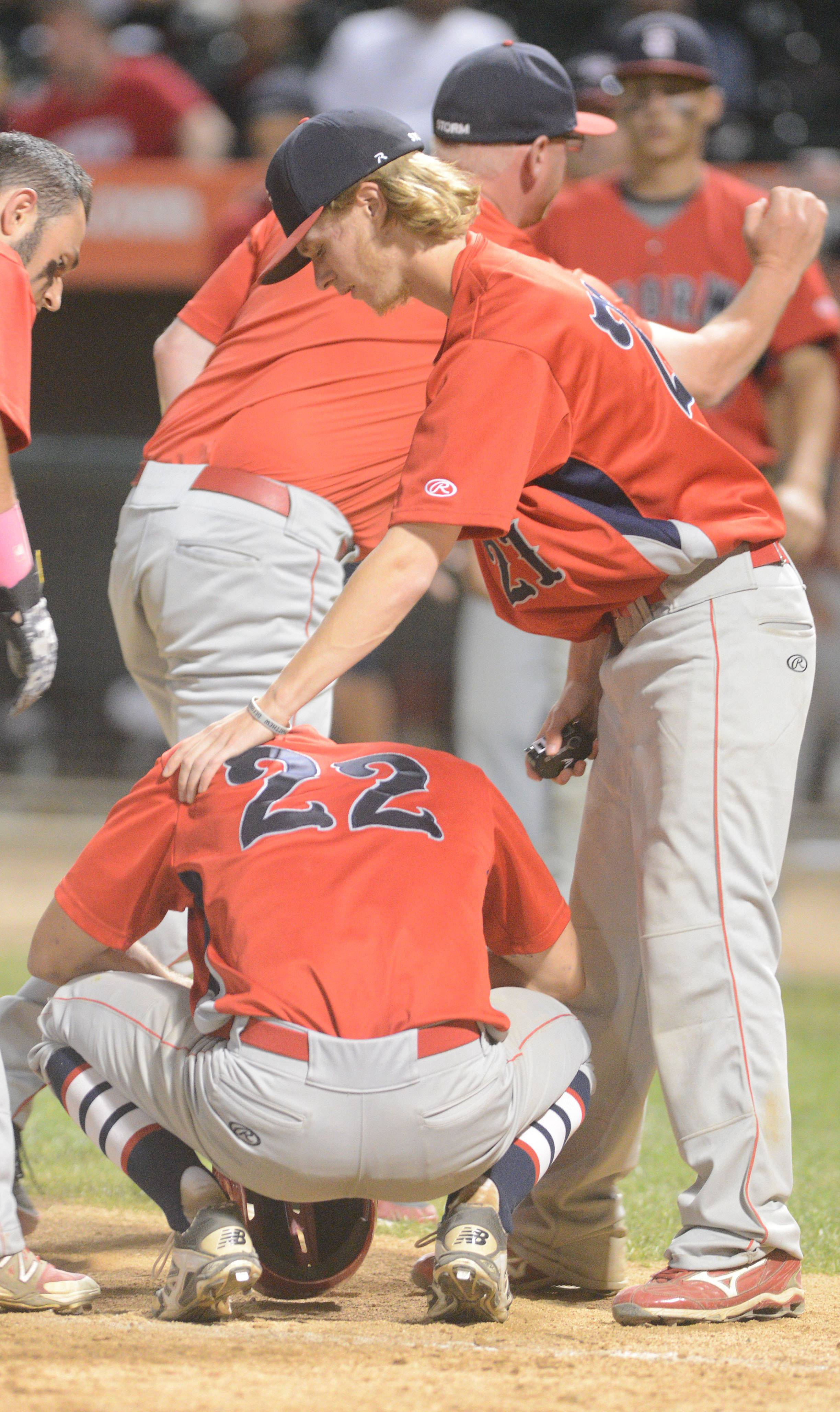 Craig Kelly (21) comforts teammate Ryan Nutof (22) after South Elgin's 3-2 loss to St. Rita in the Class 4A state semifinals Friday in Joliet.