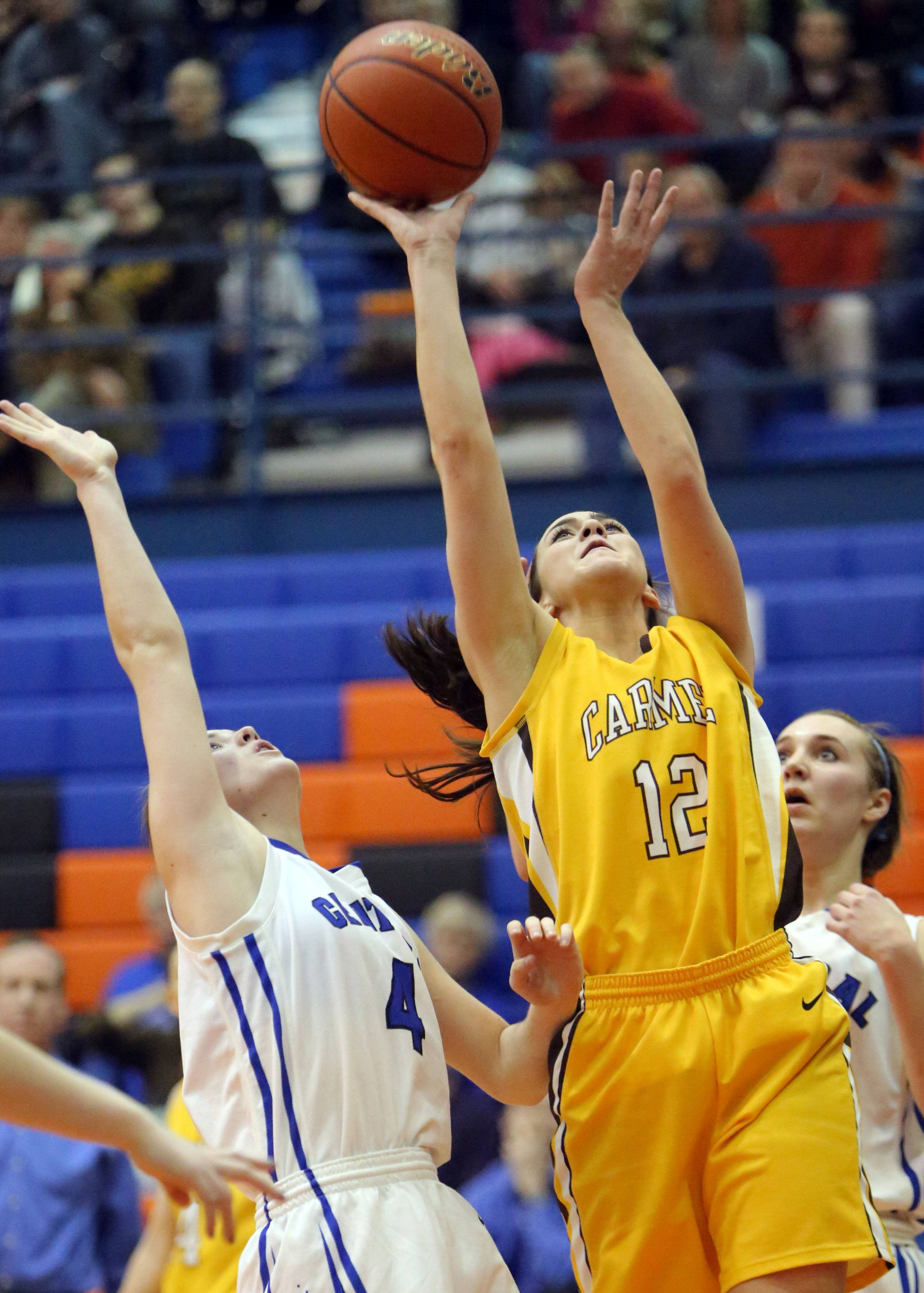 Carmel's Kathleen Felicelli, right, drives on Burlington Central's Kayla Ross during the Class 3A supersectional at Hoffman Estates.