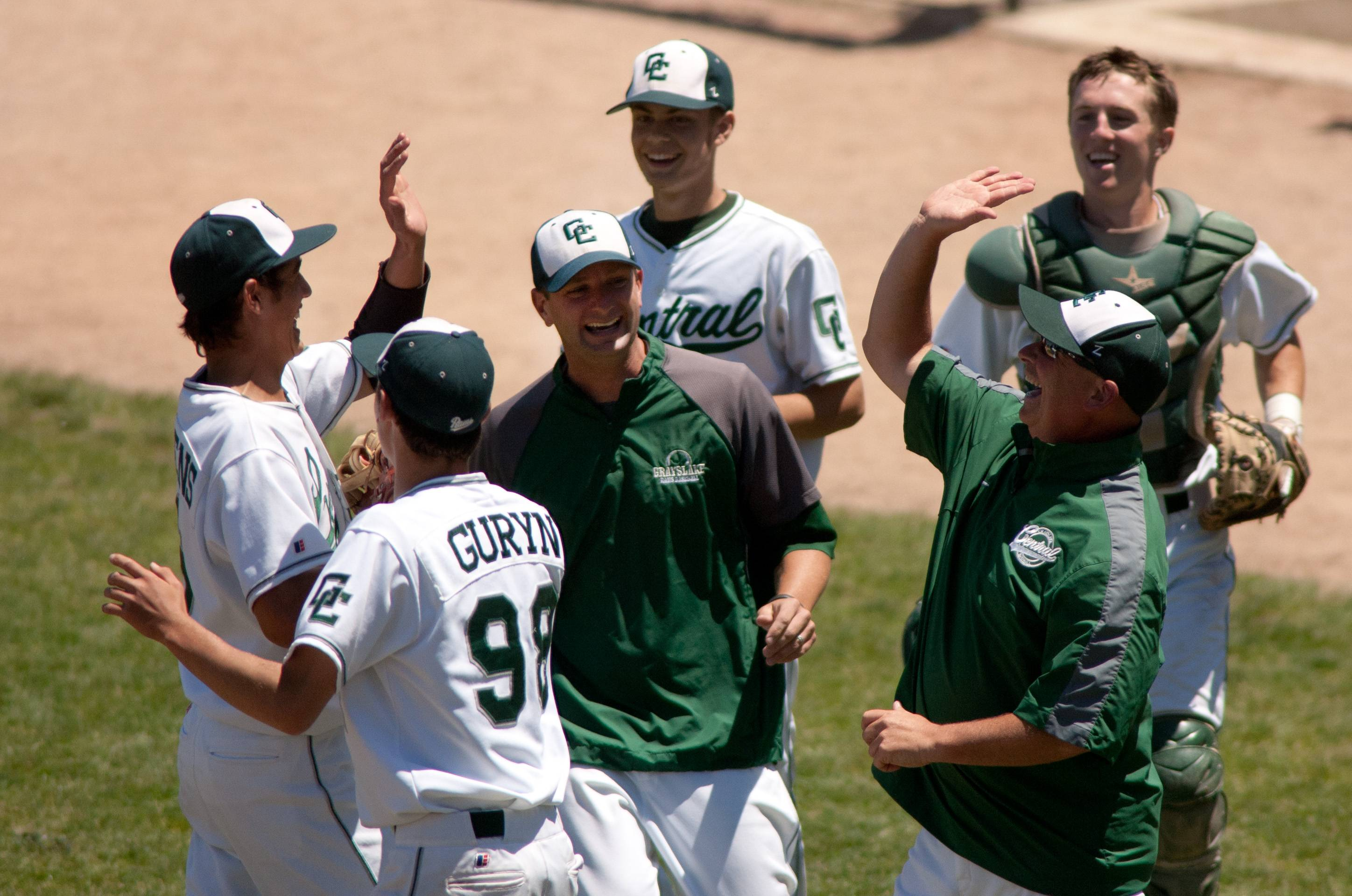 Grayslake Central pitcher David Llorens, left, is high-fived by teammates and coaches in the third inning against Springfield Sacred Heart-Griffin during the Class 3A baseball state semifinals at Silver Cross Field in Joliet.