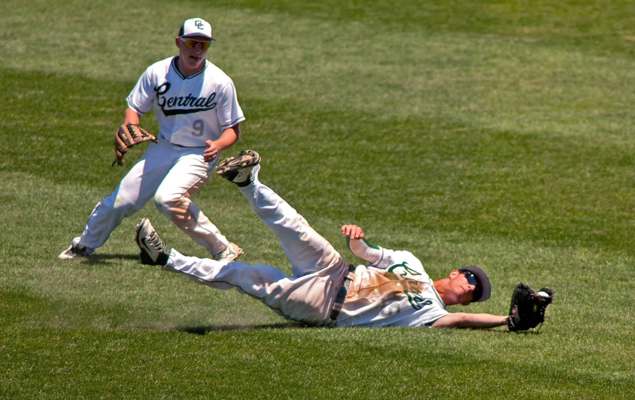 Grayslake Central center fielder Matt Loeffl makes a spectacular fourth-inning diving catch against Springfield Sacred Heart-Griffin during the Class 3A baseball state semifinals at Silver Cross Field in Joliet as right fielder Justin Dooley monitors the play.