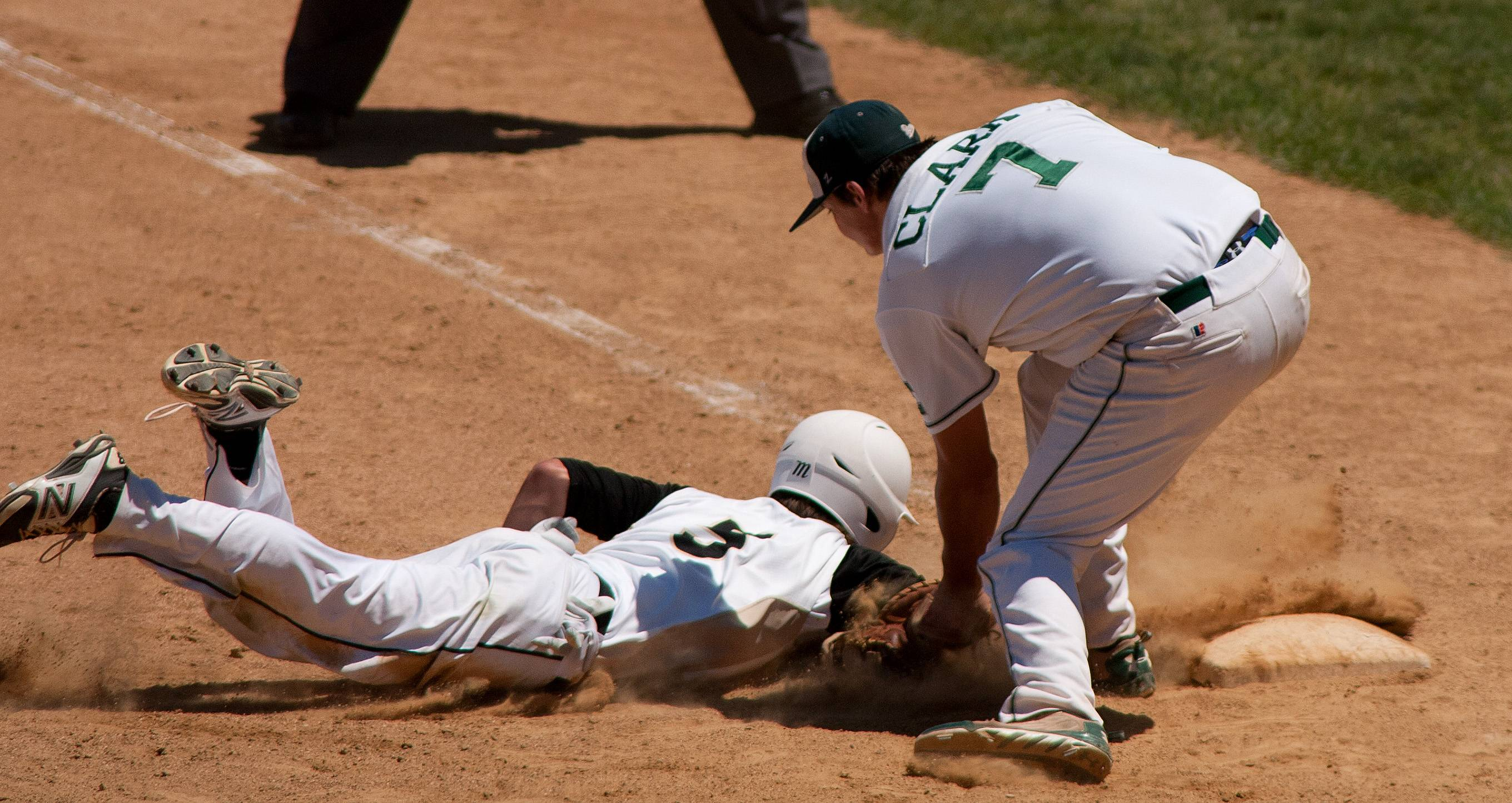 Grayslake Central's first baseman picks off Springfield Sacred Heart-Griffin's Cole Daily during the Class 3A baseball state semifinals at Silver Cross Field in Joliet.