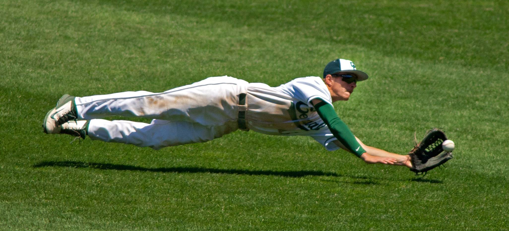 Daniel White/dwhite@dailyherald.comGrayslake Central center fielder Matt Loeffl makes a spectacular fourth-inning diving catch against Springfield Sacred Heart-Griffin during the Class 3A baseball state semifinals at Silver Cross Field in Joliet.