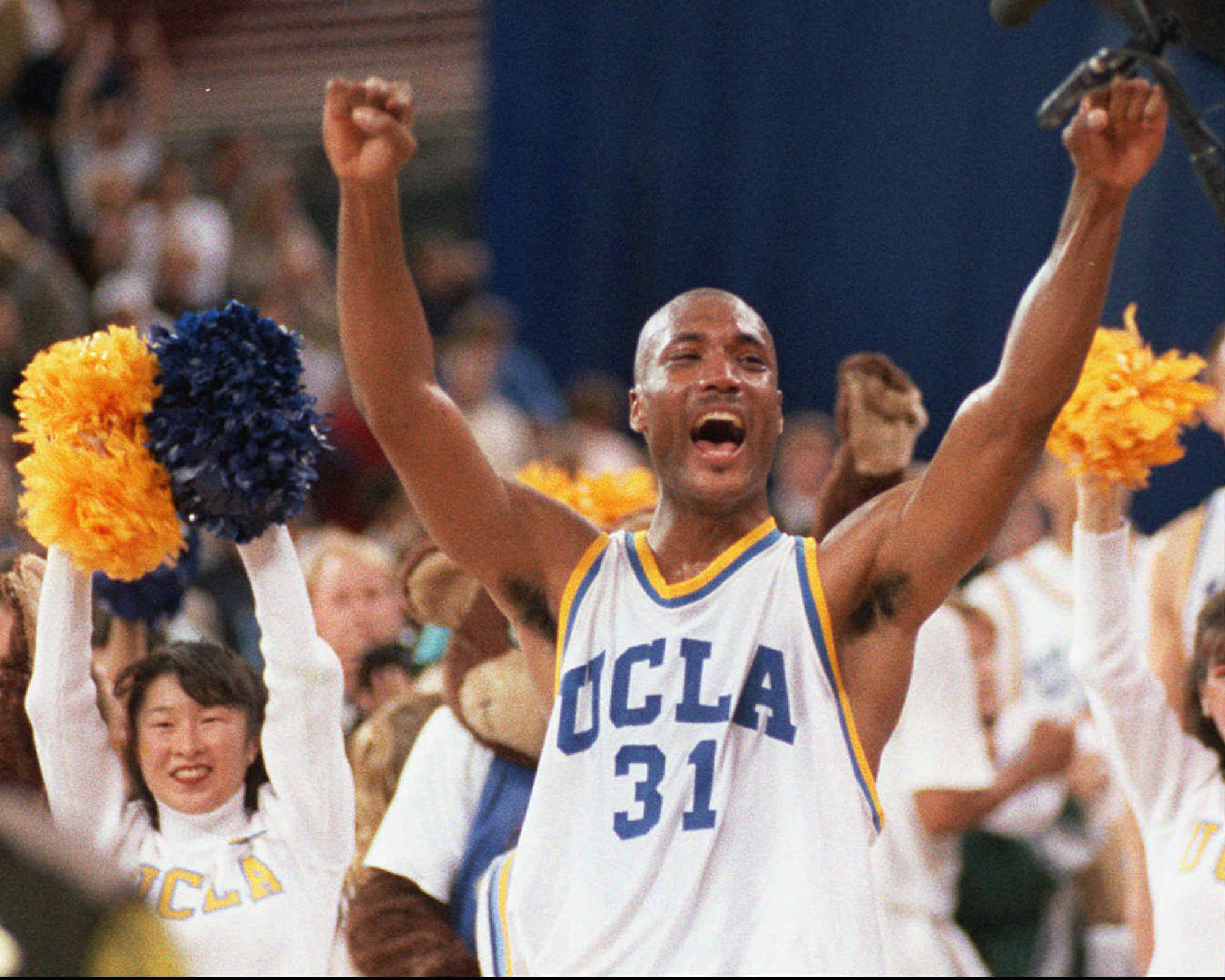UCLA's Ed O'Bannon, shown here celebrating after his team won the NCAA championship game in 1995 against Arkansas, has waited five years for his antitrust lawsuit against the NCAA to go to trial.