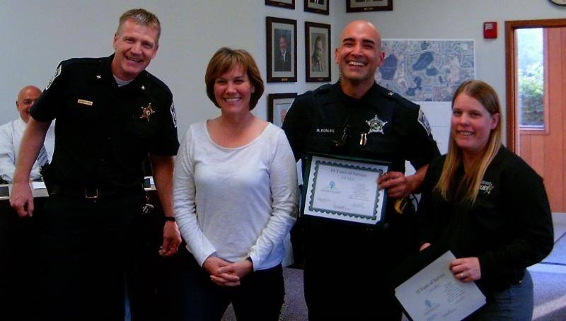 From left to right, Lindenhurst Police Chief Kevin Klahs; Mayor Susan Lahr; officer Hugo Robles; and officer/Detective Lisa Myhra. Robles and Myhra were among five village employees recently recognized for their service.