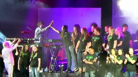 Members of the Elk Grove High School Choir performed with Foreigner June 6 at Northerly Island after winning a radio contest.