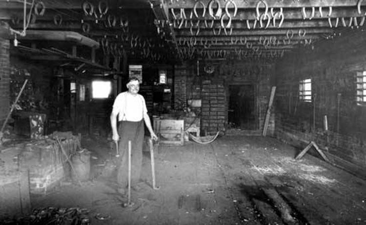 John Meyn opened the first blacksmith and wagon repair shop in Mount Prospect in 1883. This photo shows him in the shop about 1905.