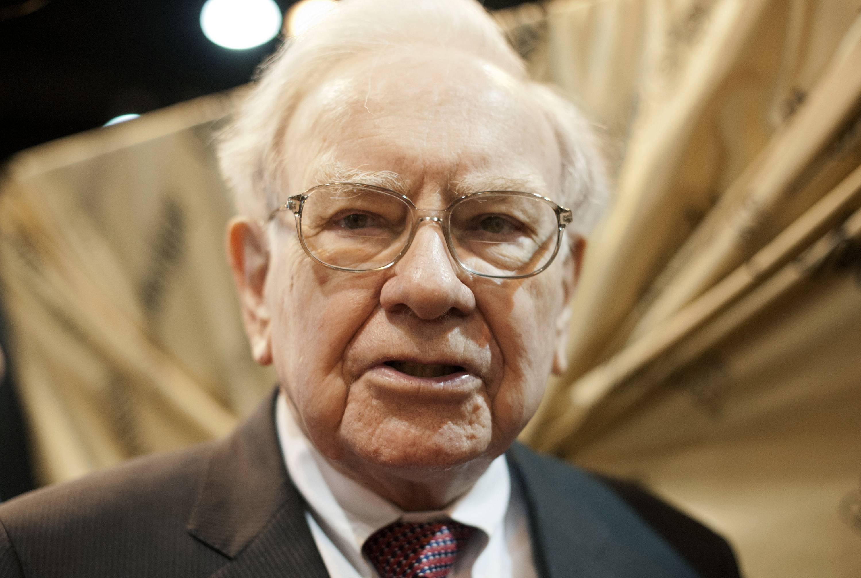 Warren Buffett, chairman of Berkshire Hathaway Inc., tours the exhibition floor prior to the Berkshire Hathaway shareholders meeting in Omaha, Nebraska, U.S.