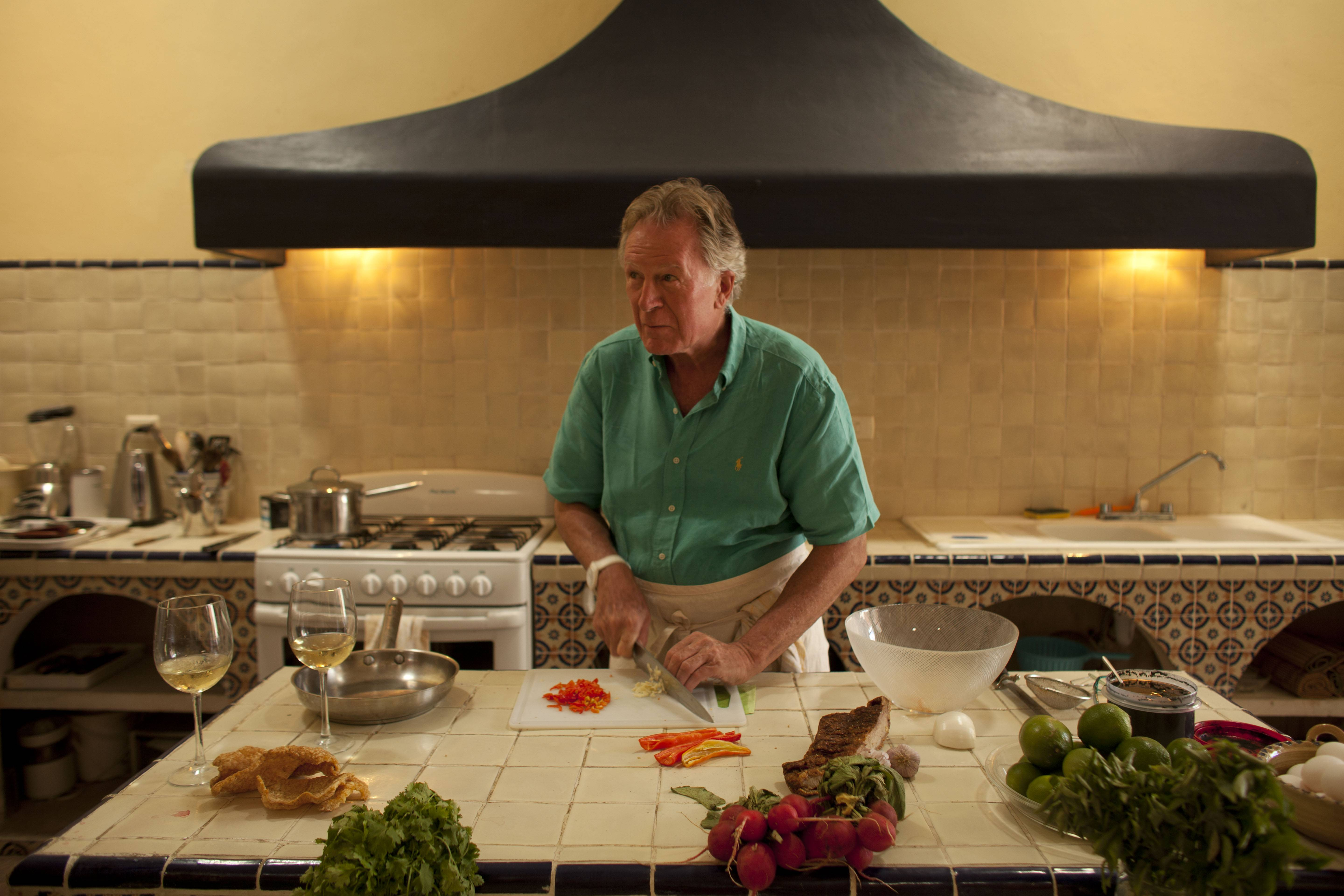 "American chef Jeremiah Tower prepares the kitchen at his home after shopping at local markets in Merida, Mexico. Tower said he sees his book, working title ""Sexual Eating,"" as a remedy to the over-serious treatment of food by modern American chefs, critics and consumers, the unfortunate extension of a trend that he helped create."
