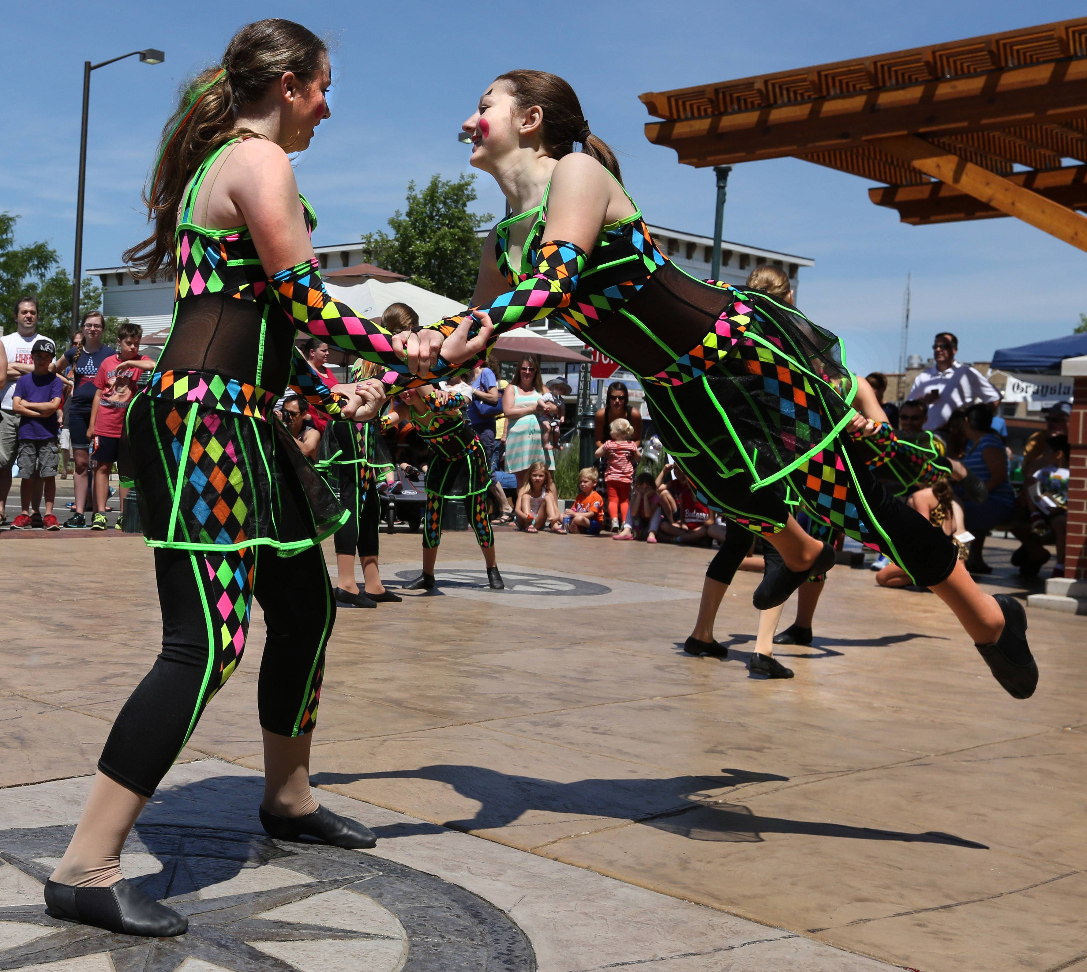Samantha Steffen swings Samantha Smith while dancing to pop and rock music as they preform with Dance Connection in Grayslake at the 19th annual Grayslake Arts Festival on Saturday.