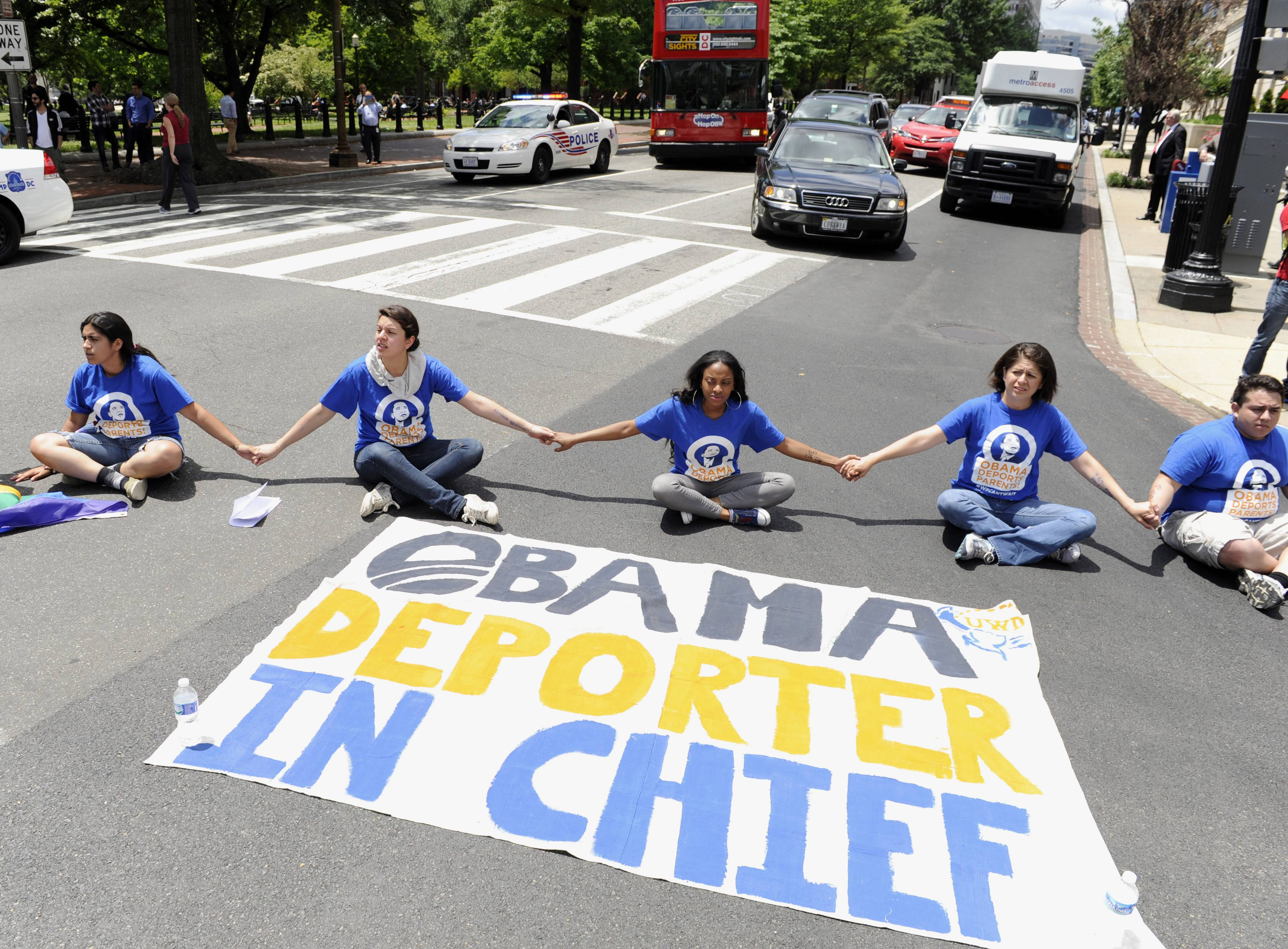 Protestors block traffic near the White House in Washington in response to President Obama's decision to delay the deportation review he ordered from the Department of Homeland Security.