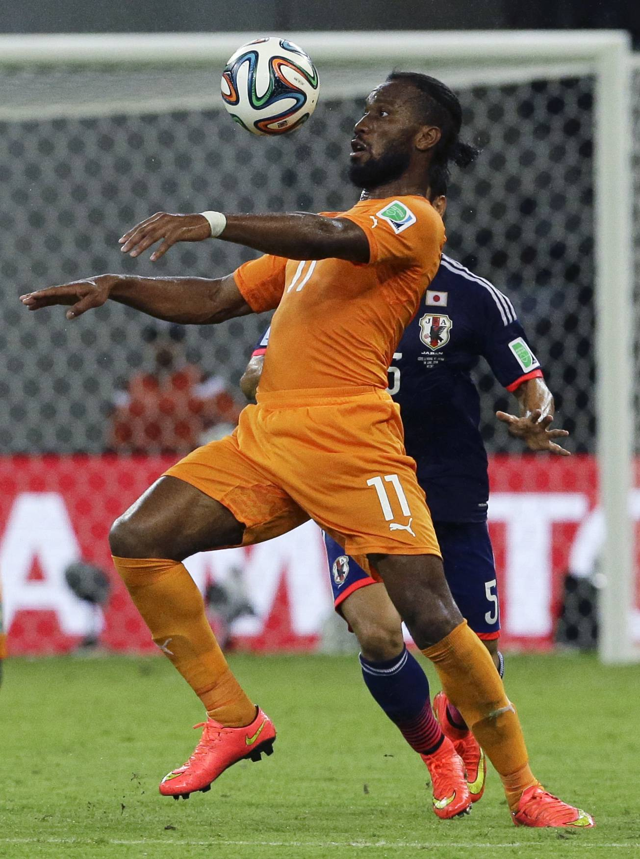 Ivory Coast's Didier Drogba eyes the ball during the group C World Cup soccer match between Ivory Coast and Japan Saturday at the Arena Pernambuco in Recife, Brazil. Ivory Coast won the match 2-1.