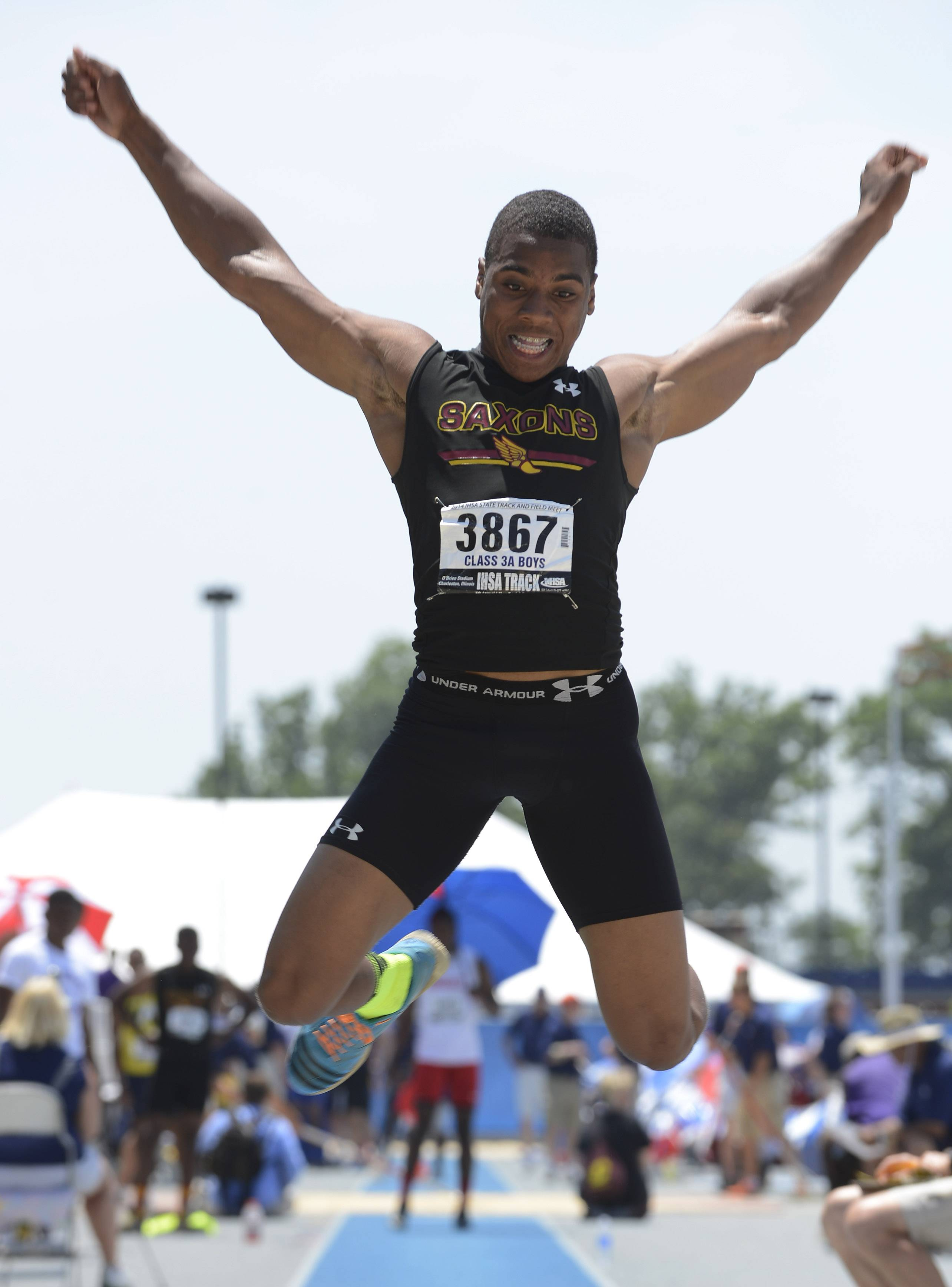 Schaumburg's Stacey Smith competes in the triple jump during the Class 3A boys track and field state finals in Charleston.