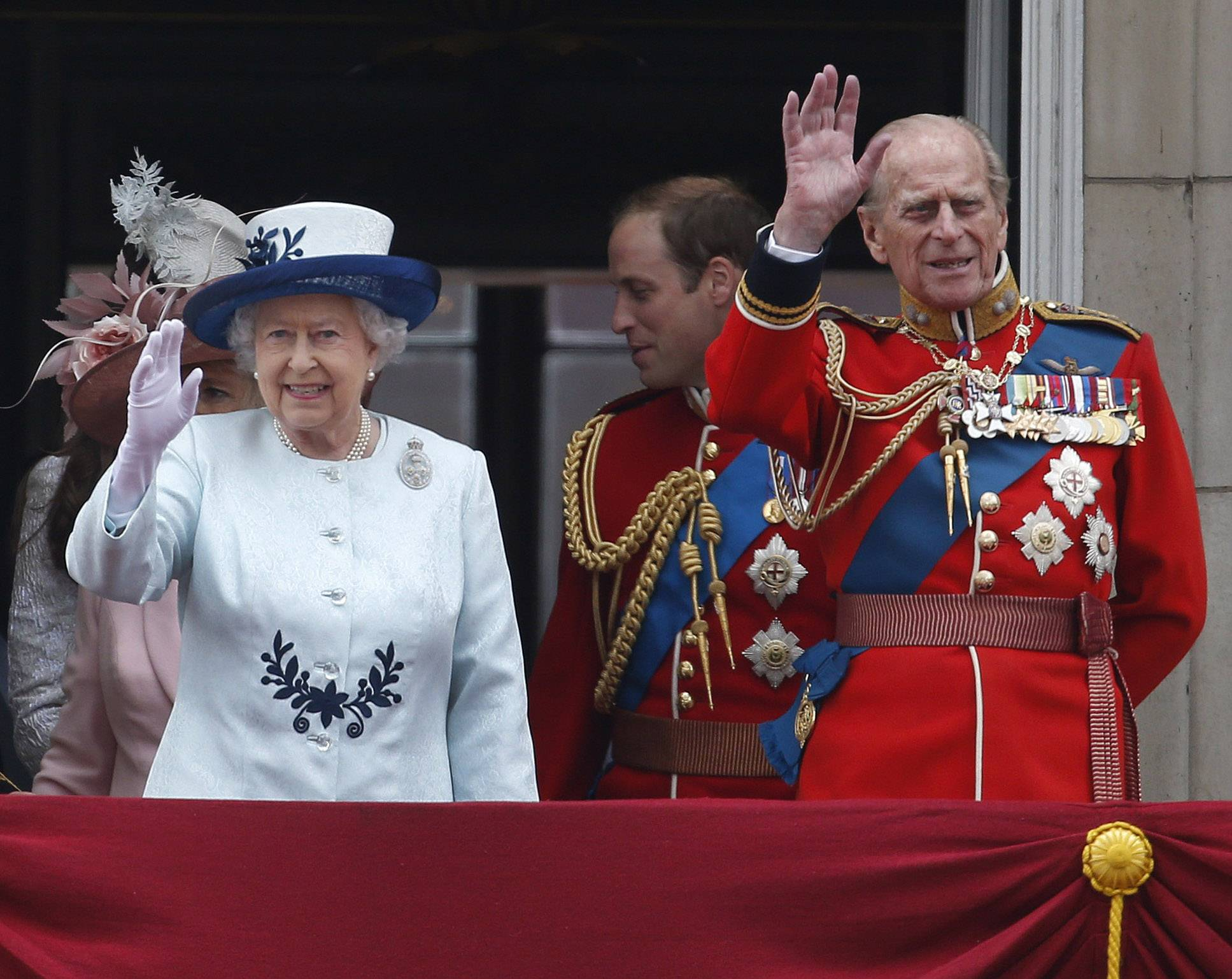 "Britain's Queen Elizabeth II, accompanied by Prince Philip, wave to the crowds, on the balcony of Buckingham Palace, during the Trooping The Colour parade, in central London, Saturday, June 14. Hundreds of soldiers in ceremonial dress have marched in London in the annual ""Trooping the Color"" parade to mark the official birthday of Queen Elizabeth II. ""Trooping the Color"" originated from traditional preparations for battle, when flags were carried or ""trooped"" down the rank for soldiers to see."