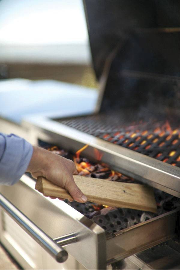 Kalamazoo's Hybrid Fire Grill allows chefs to open a drawer, insert some wood or choose another fuel that suits the preparation.