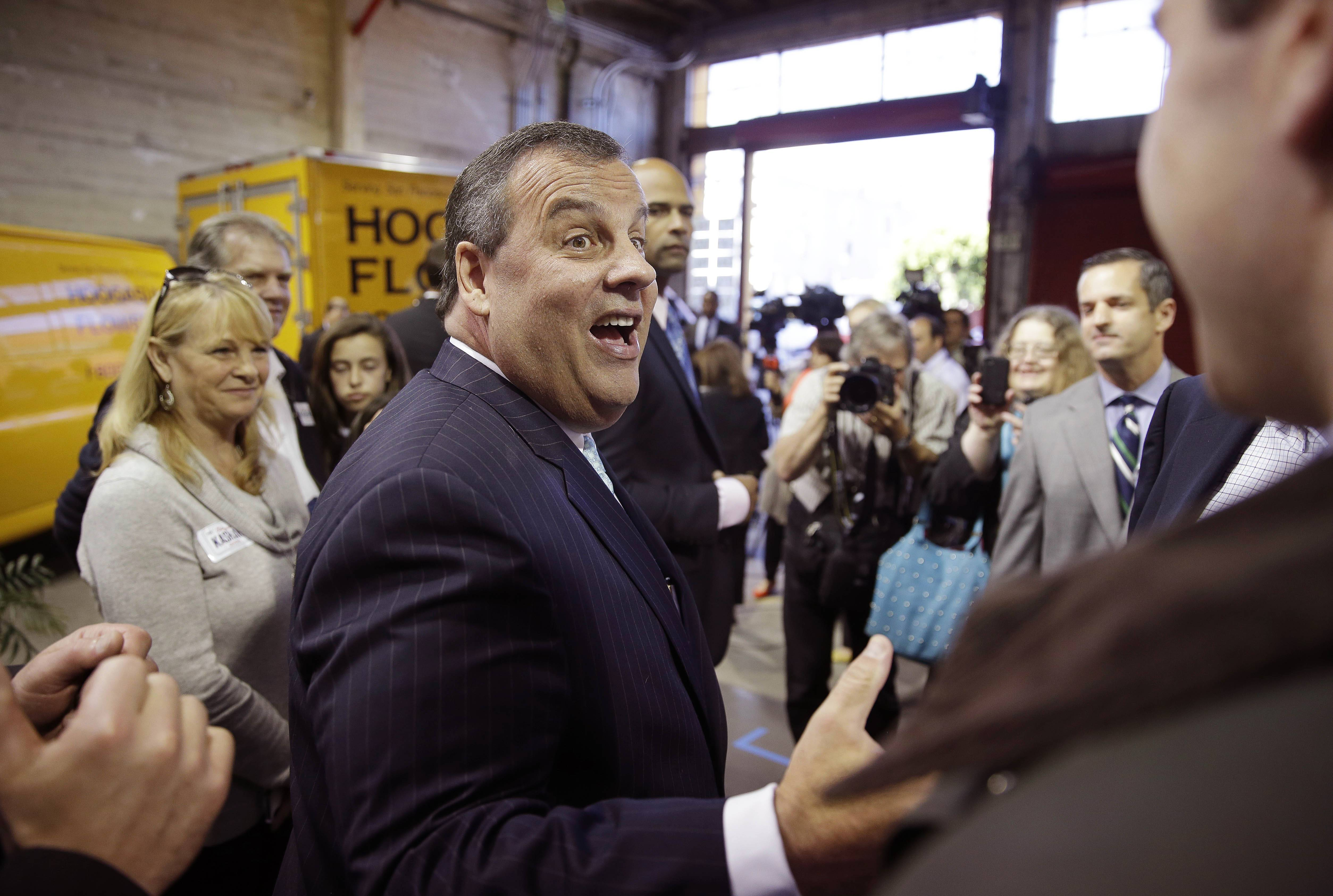 New Jersey Gov. Chris Christie shakes hands with supporters Friday during a visit to Hoogasian Flowers in San Francisco.