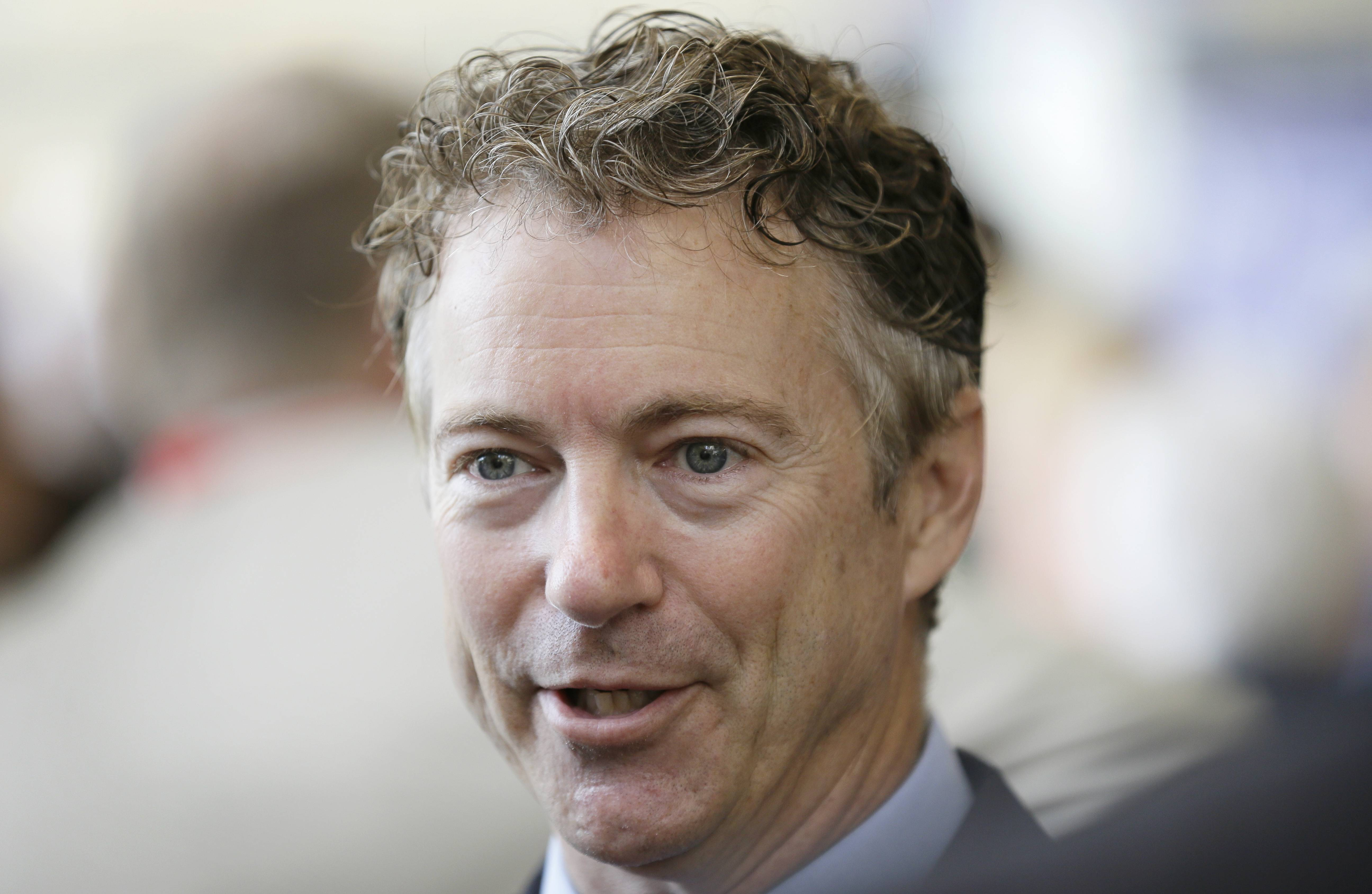 U.S. Sen. Rand Paul, R-Ky., talks with delegates Saturday during the Iowa State Republican Convention.
