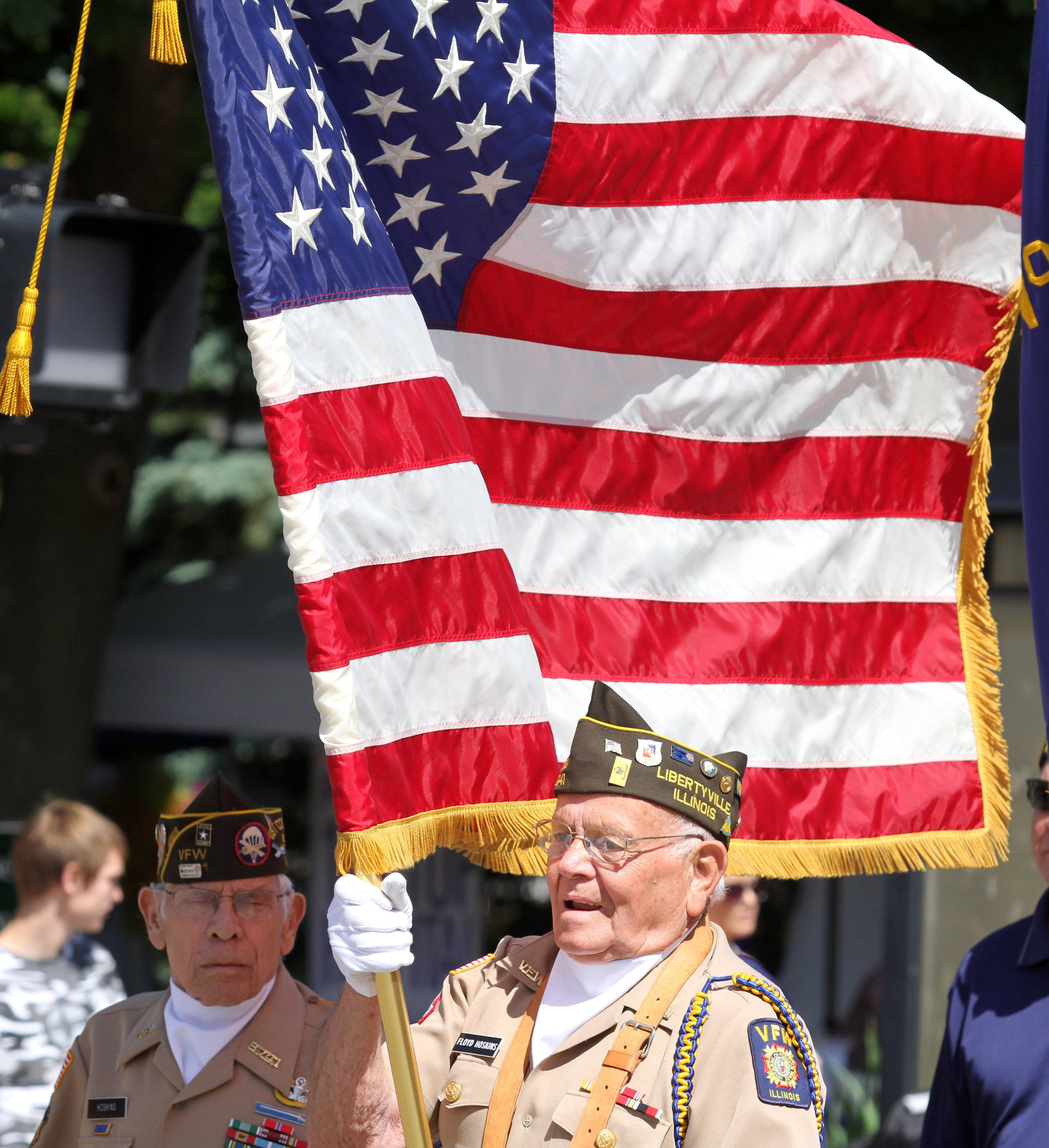 Floyd Hoskins with VFW Post 8741 leads off Libertyville Days Parade on Saturday.