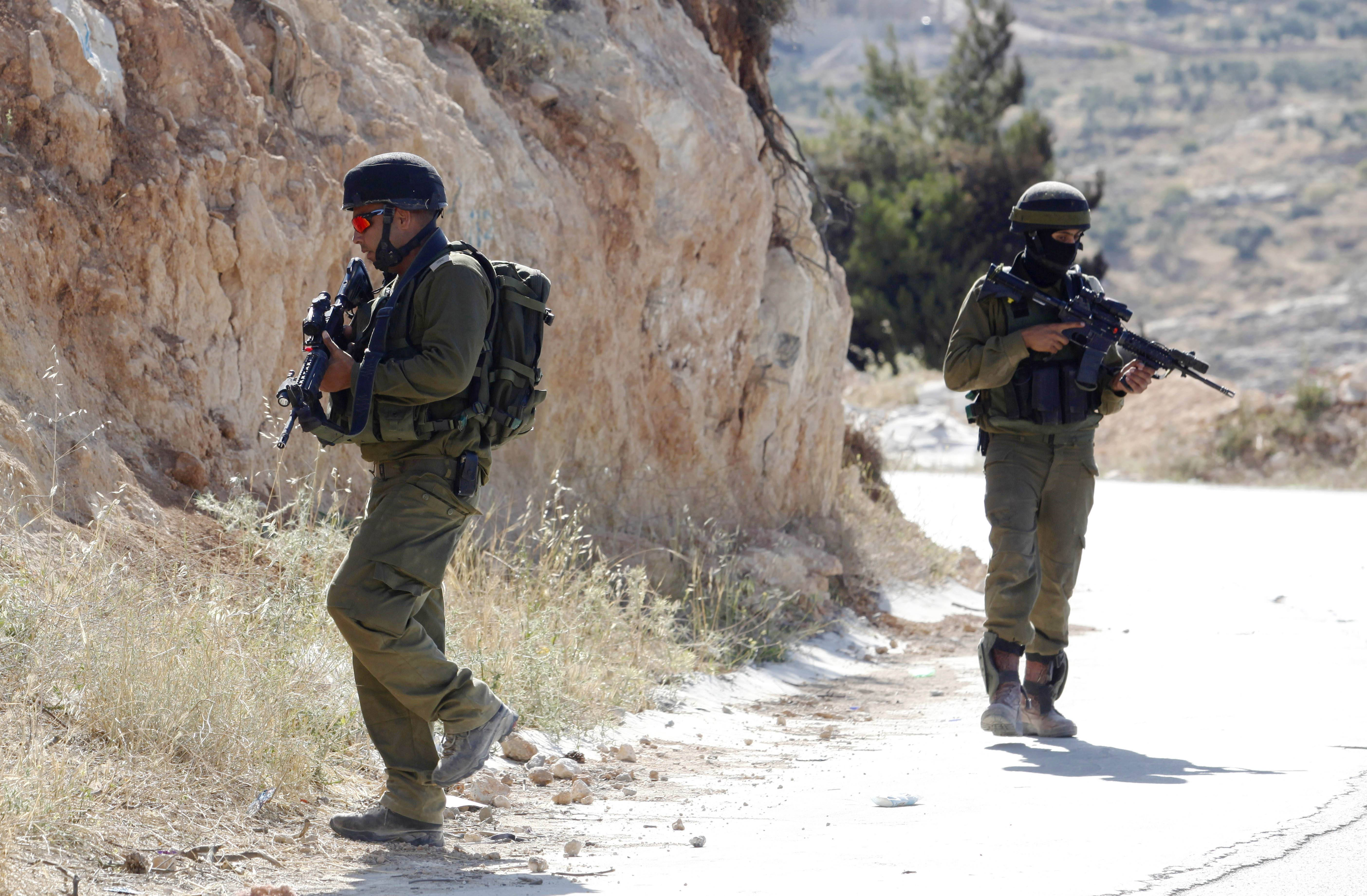 Israeli soldiers search for missing teens Saturday.