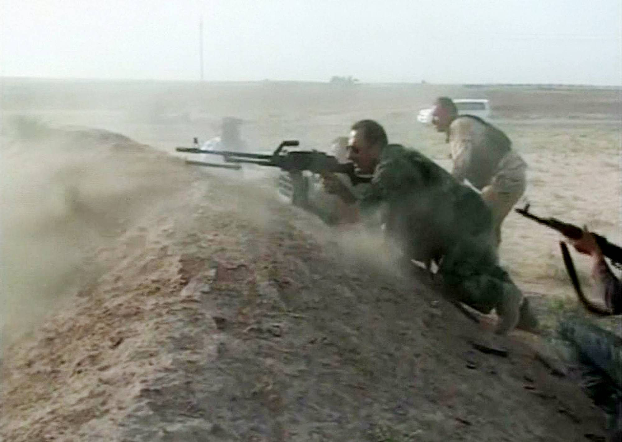 This image made from video shows Kurdish Peshmerga security forces fighting militants Saturday from the al-Qaida inspired Islamic State of Iraq and the Levant (ISIL) in Tel Al Wared, west of Kirkuk, Iraq. After a decades-long dispute between Arabs and Kurds over the oil-rich northern Iraqi city of Kirkuk, it took just an hour and a half for its fate to be decided.