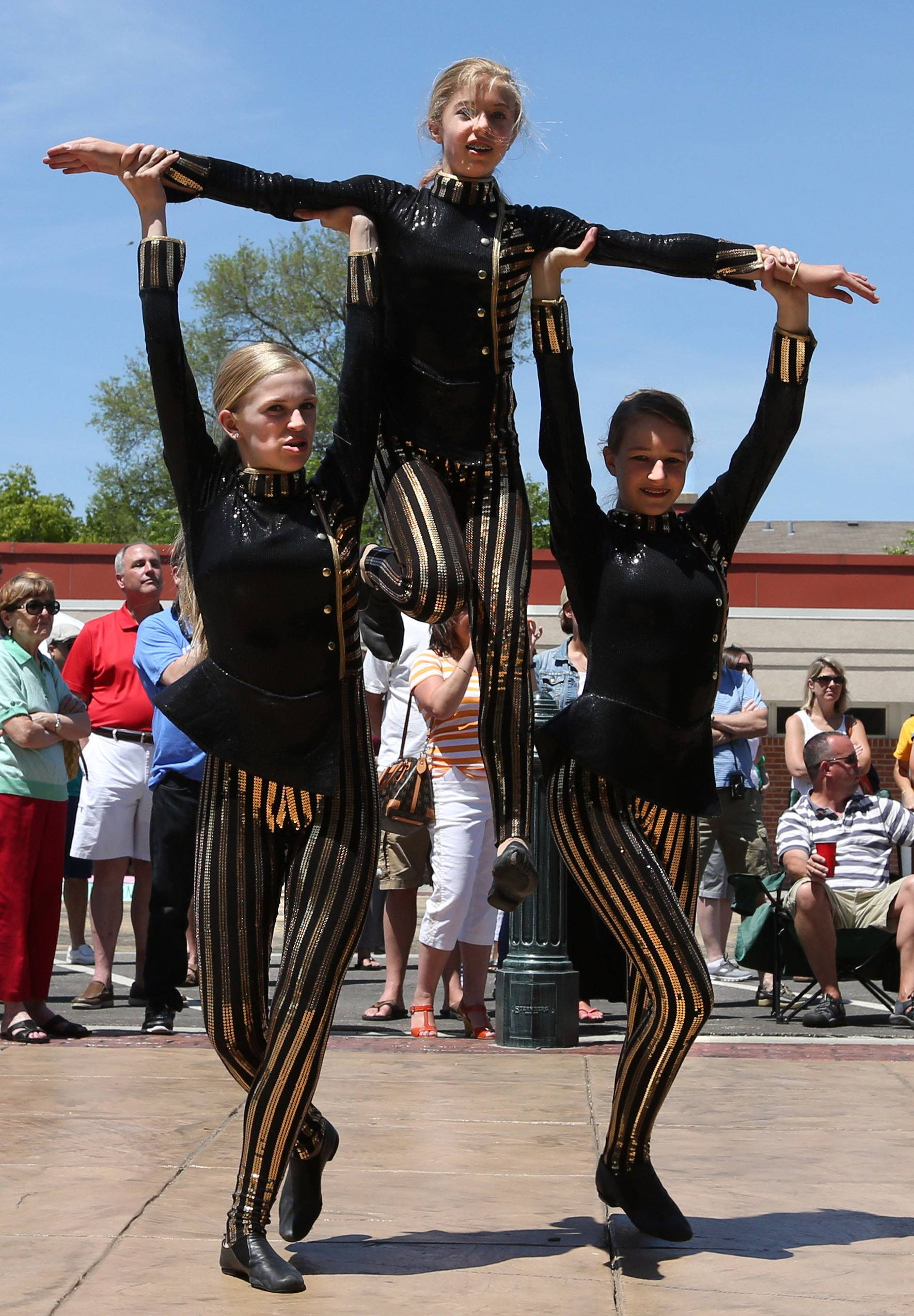Shannon Leahy, left, and Analise Steeber lift Jadie Kissner while dancing to pop and rock music as they preform with Dance Connection in Grayslake at the 19th annual Grayslake Arts Festival on Saturday.