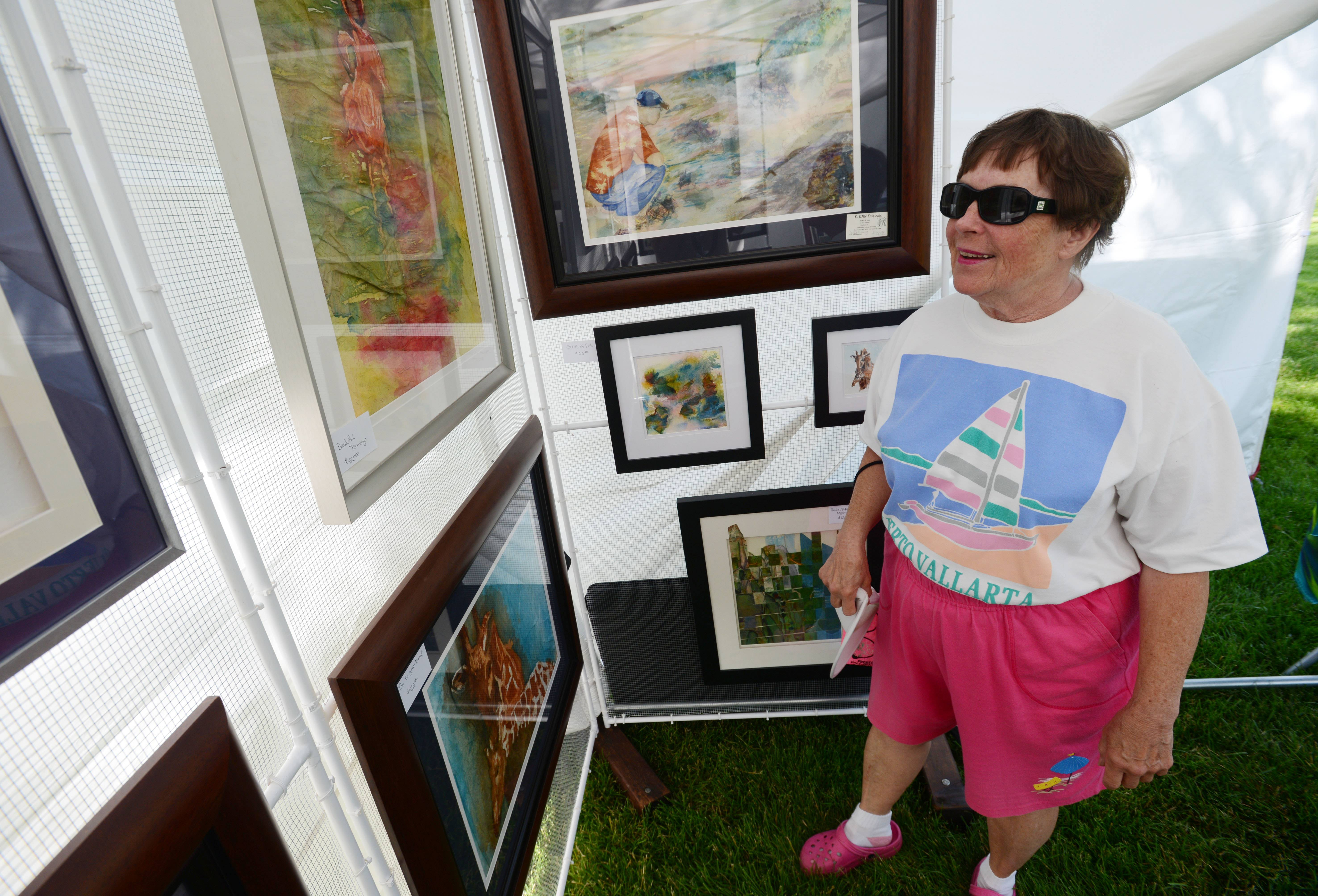 Carol Veto of South Barrington looks at the art of Kathy Lesle of Chatham, Ill. The Art in Bloom festival ran from 10 a.m. to 5 p.m. Saturday and 10 a.m. to 4 p.m. Sunday at Cantigny Park in Wheaton