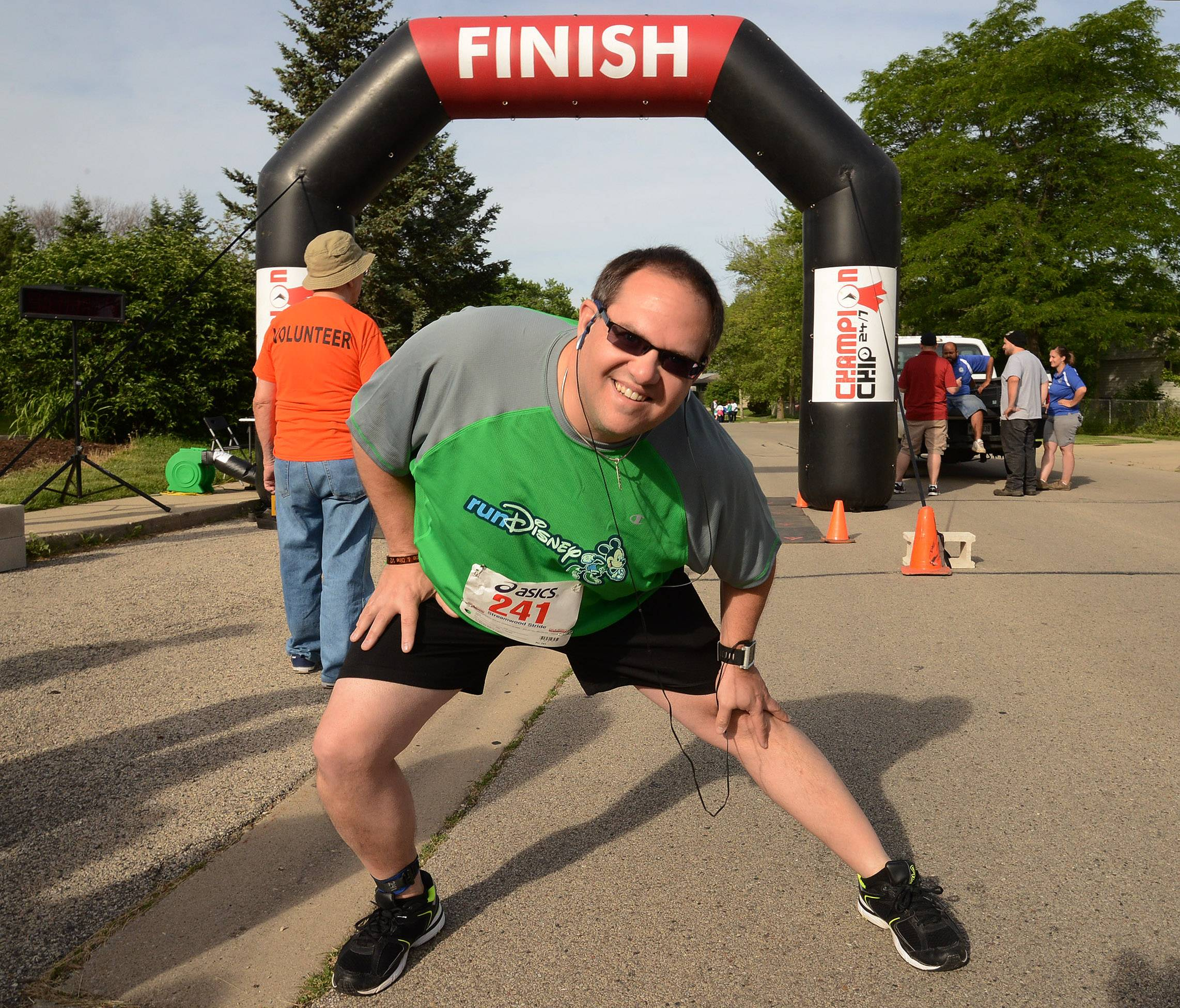 Paul Kobos of Streamwood stretches before the start of the Streamwood Stride 5K/10K/Fun Run Saturday morning at the Park Place Family Recreation Center. Kobos lives down the street and considers this his home race.
