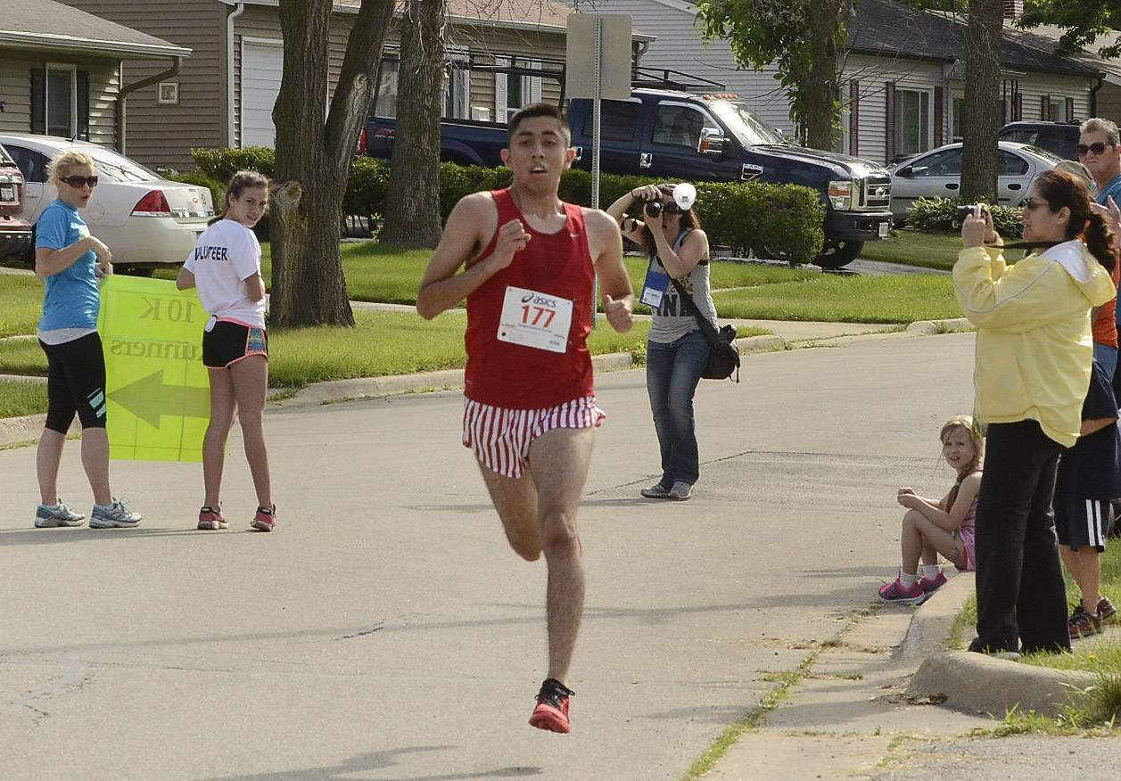 Daniel Robles of Streamwood finished with the fastest time for the 5K at 17:09 during the Streamwood Stride 5K/10K/Fun Run Saturday morning at the Park Place Family Recreation Center. Robles runs track at North Central College in Naperville.