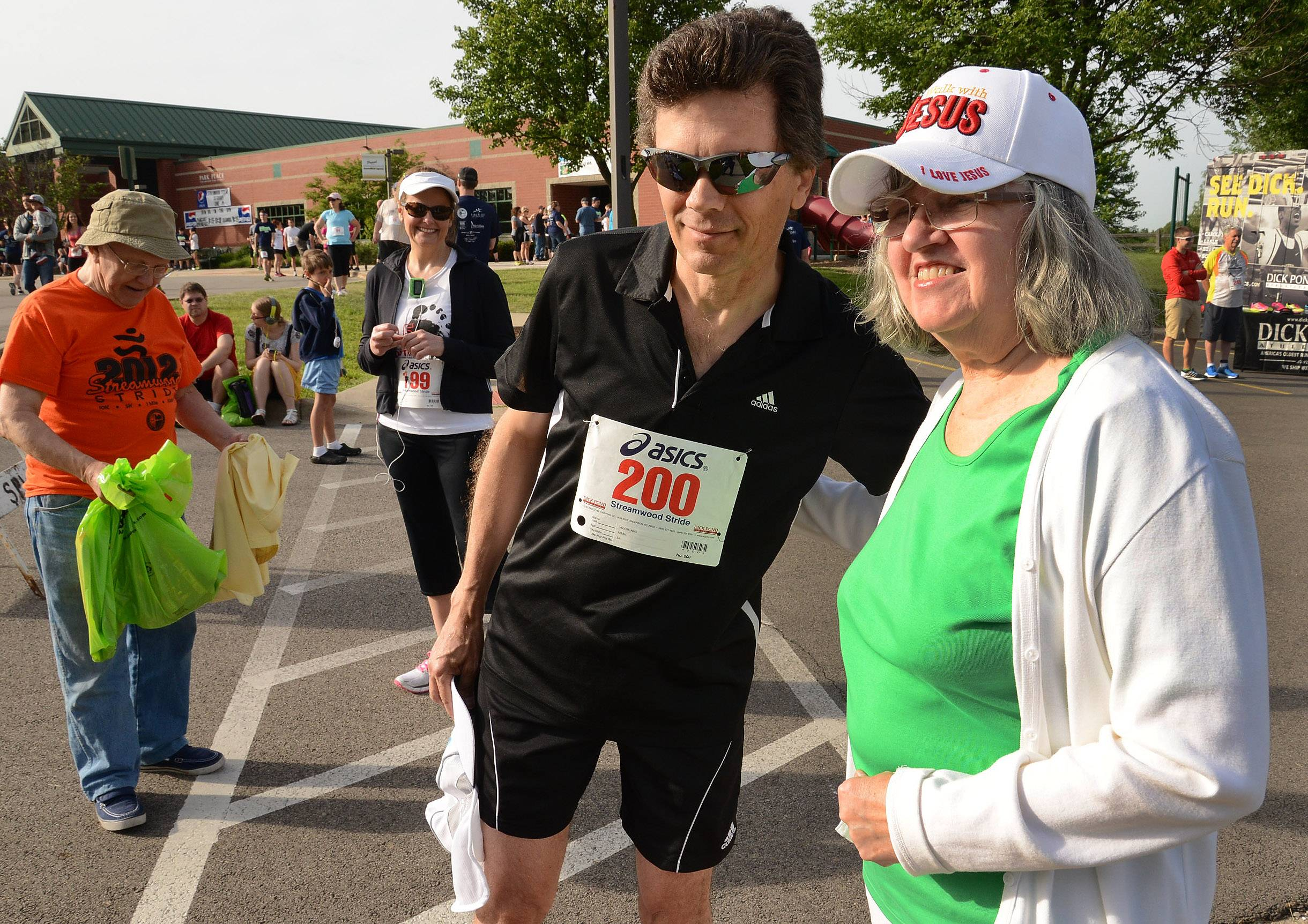 Mark Skolozynski of Elgin gets some encouragement from his mother, Carol Skolozynski of Streamwood, before the Streamwood Stride 5K/10K/Fun Run Saturday morning at the Park Place Family Recreation Center. Carol Skolozynski has been running for fifteen years and won the gold last year at the age of 72. This year a bad back is keeping her out of the event.