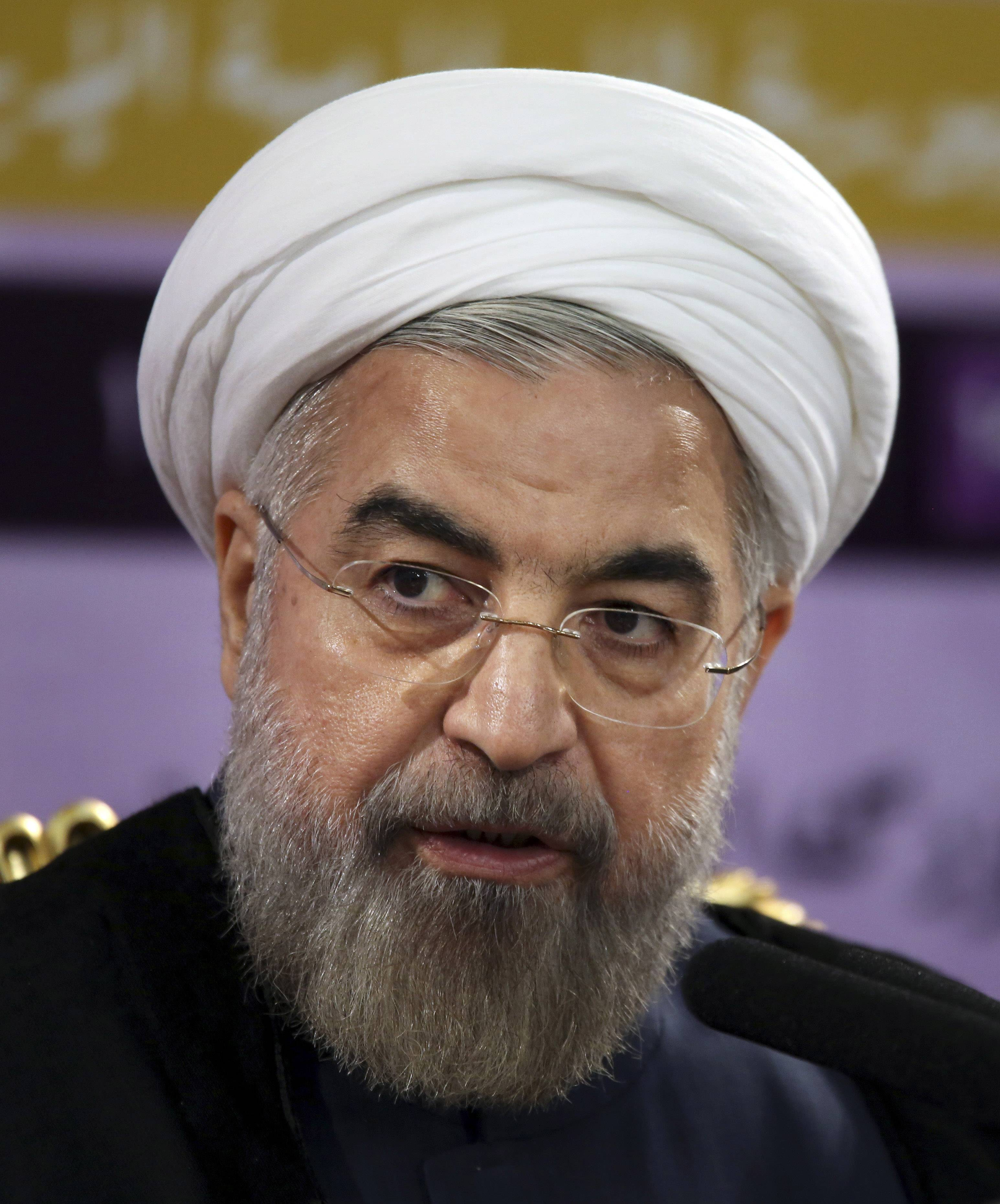 Iranian President Hassan Rouhani speaks during a press conference in Tehran, Iran, Saturday, June 14. Rouhani says the international sanctions regime has crumbled and will not be rebuilt even if Iran and world powers fail to reach a final nuclear deal by a July 20 deadline. Iran and the five permanent members of the U.N. Security Council plus Germany reached an interim deal in November that limited Iran's uranium enrichment program in exchange for the easing of some sanctions.
