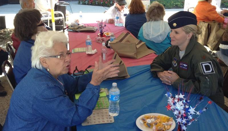 Air Force Major Gina Stramaglio of Schaumburg, right, speaks with Joan Creevy of Schaumburg at Schaumburg's Flag Day ceremony and senior picnic Friday.