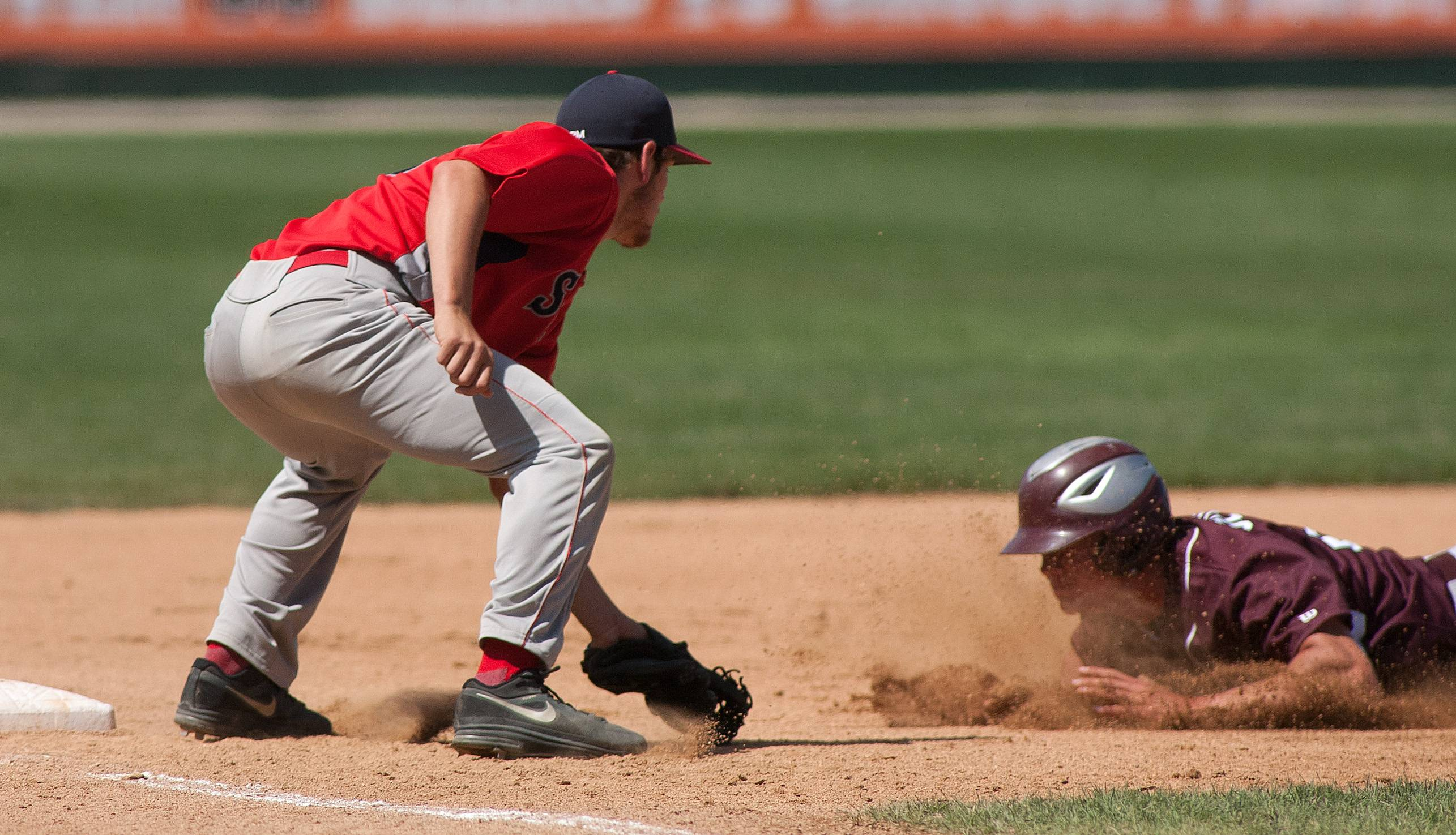 South Elgin third baseman Kyle Hays, left, tags out Prairie Ridge's Carson Getzelman to end the first inning of the Class 4A third-place game at Silver Cross Field in Joliet.