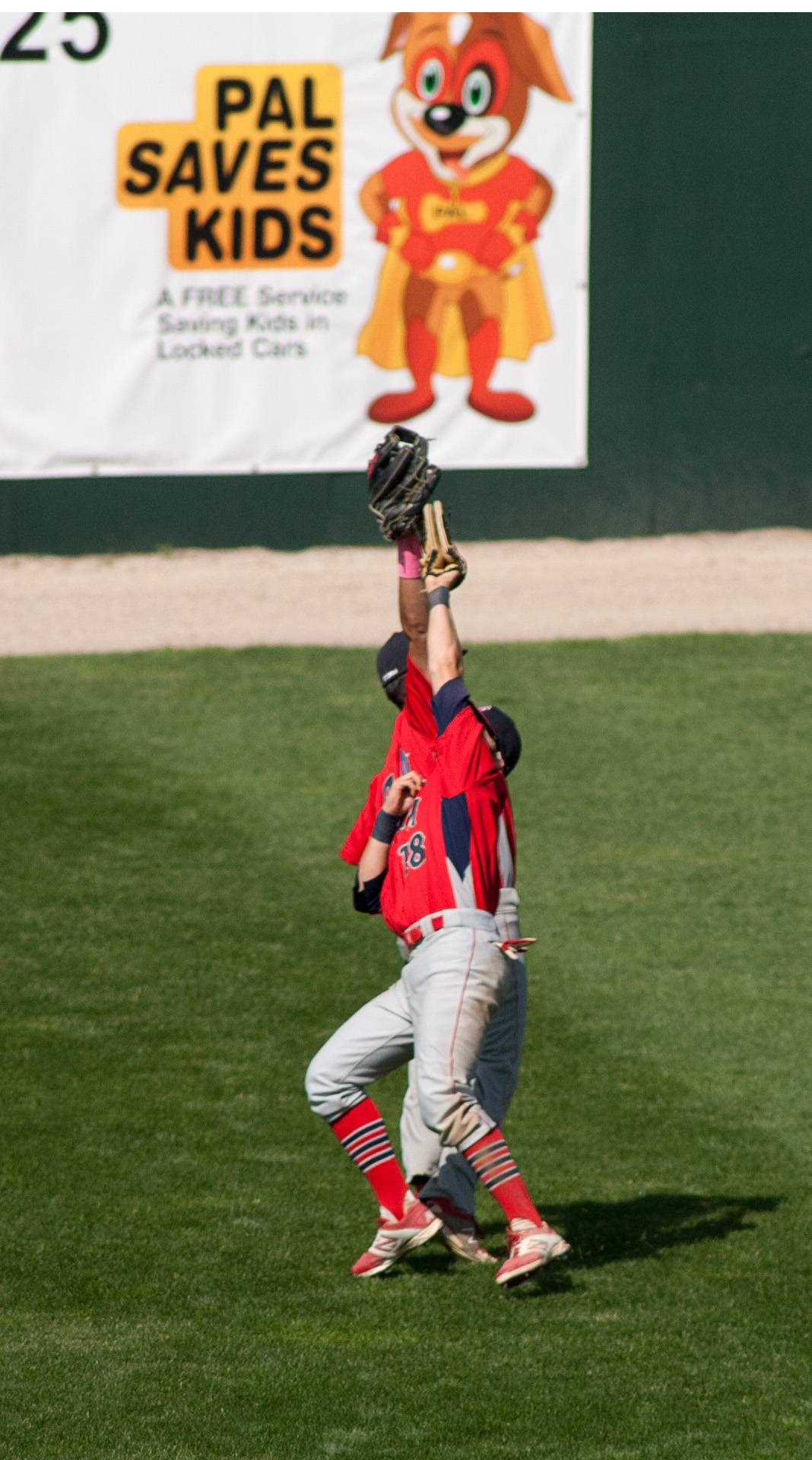 South Elgin outfielders Antonio Danesi (28) and Nick Menken (18) nearly collide in the fourth inning on a flyball during the Class 4A third-place game at Silver Cross Field in Joliet.