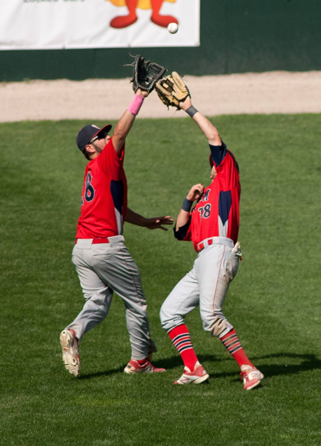 South Elgin outfielders Antonio Danesi (28) and Nick Menken (18) nearly collide in the fourth inning while chasing a flyball during the Class 4A third-place game at Silver Cross Field in Joliet.