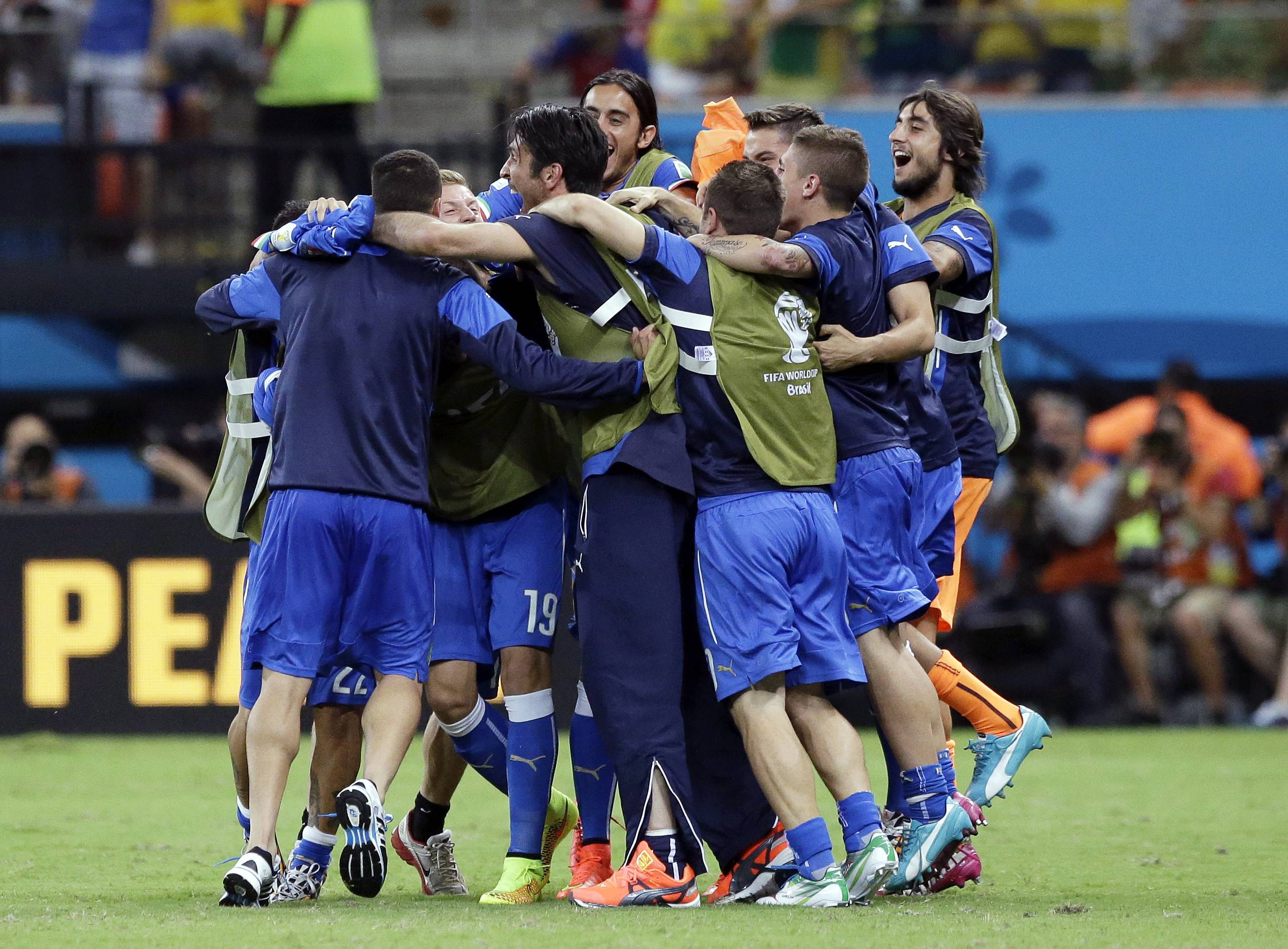 Italian players celebrate after the group D World Cup soccer match between England and Italy at the Arena da Amazonia in Manaus, Brazil, Saturday, June 14, 2014. Italy won the match 2-1.