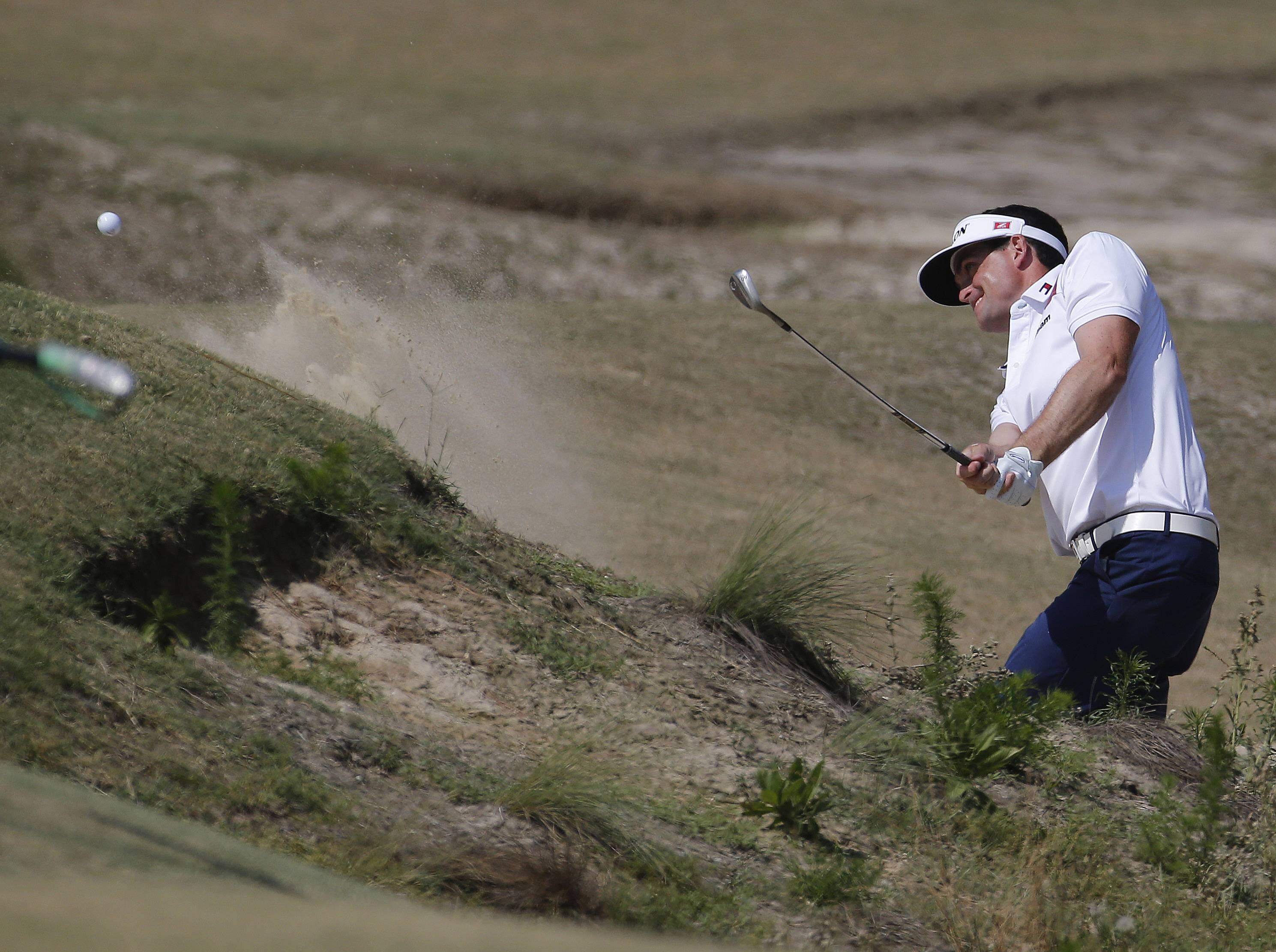 Aaron Baddeley, of Australia, hits out of the bunker on the fifth hole during the third round of the U.S. Open golf tournament in Pinehurst, N.C., Saturday, June 14, 2014.