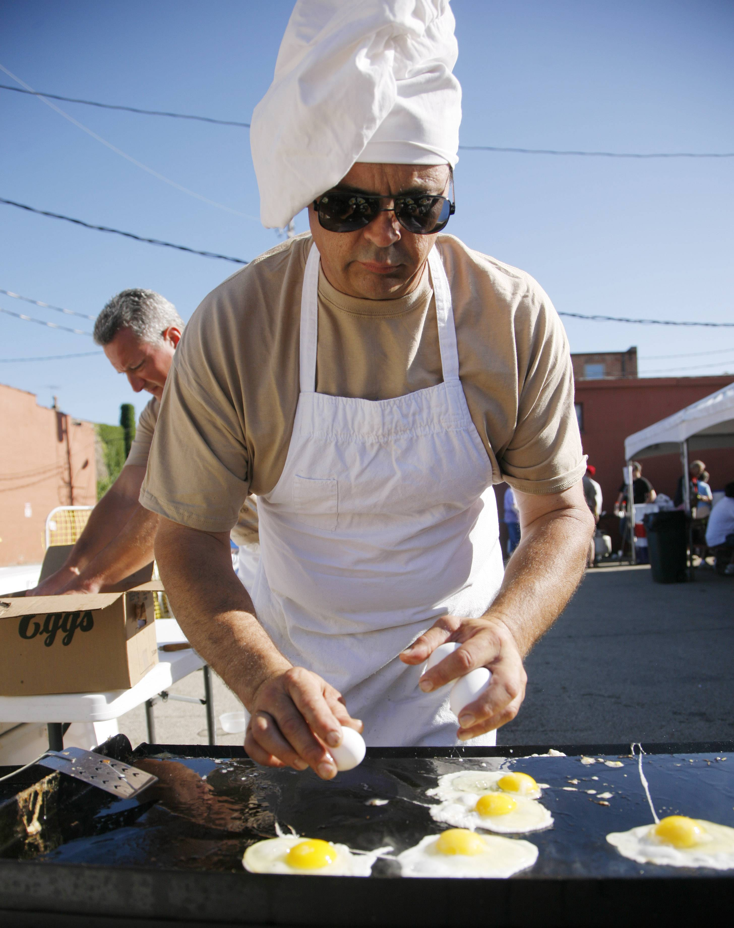 Bud Meisner of Geneva gets started on cooking eggs for a previous all-you-can-eat breakfast at Geneva's Swedish Days.